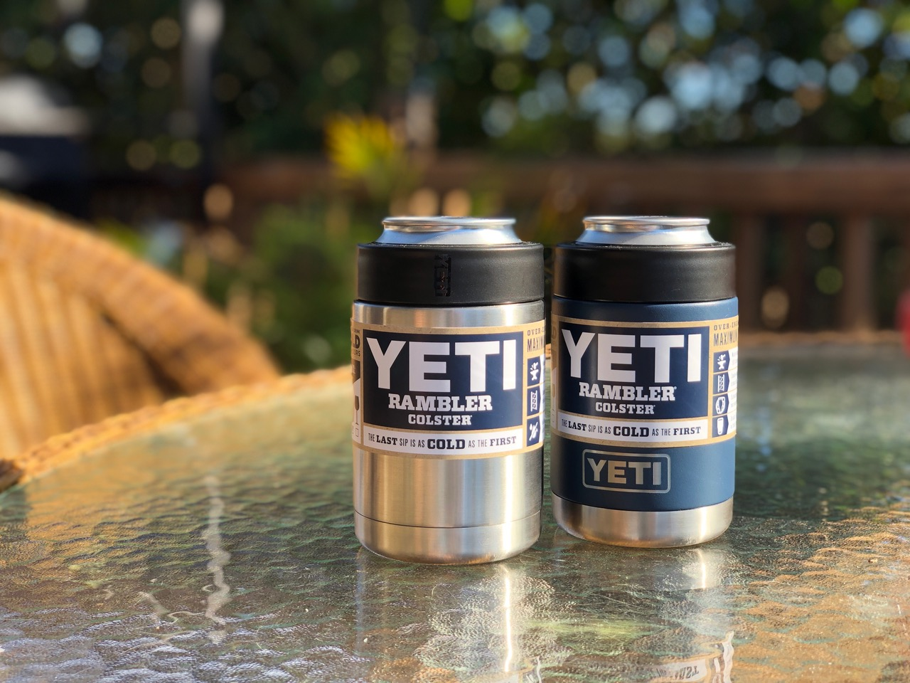 Two YETI Rambler Colsters on Table (Stainless & Navy)
