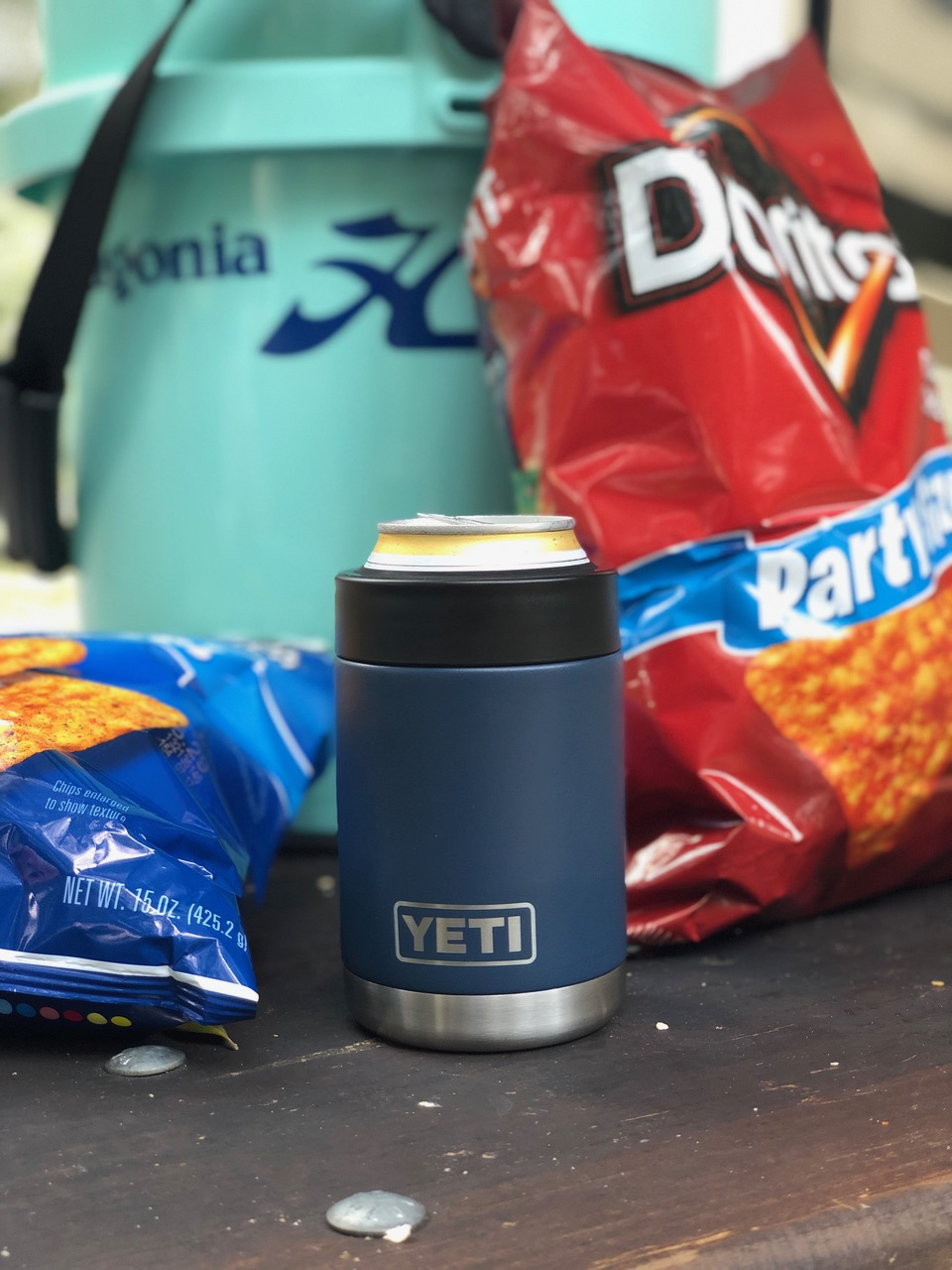 Two YETI Rambler Colster On Table With YETI Loadout Bucket