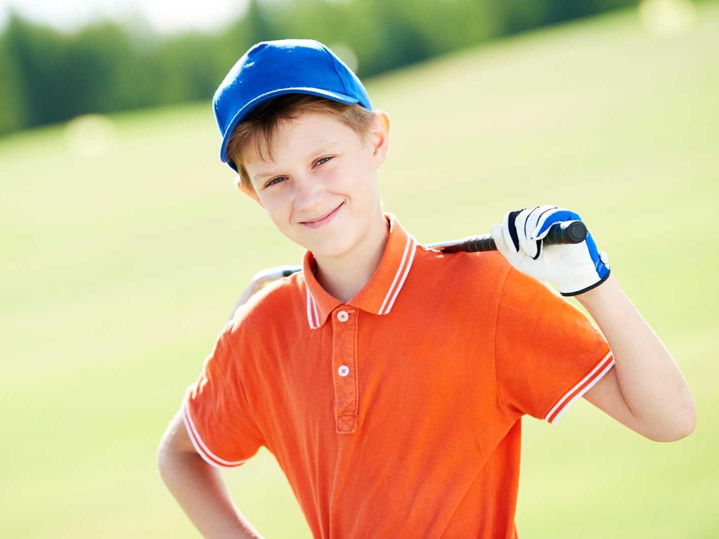 web-Boy-golf-player-portrait-with--200151028.jpg