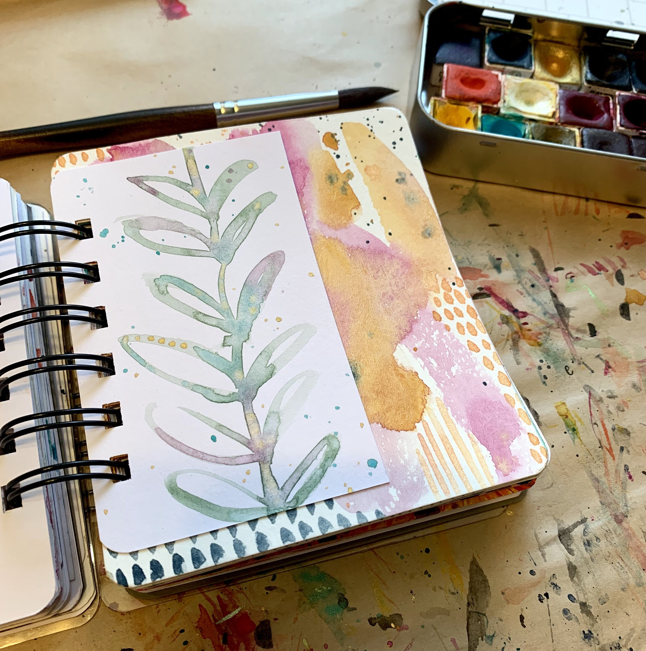 Leaves, stems and other such shapes are a great way to experience working wet on wet. It's also a fabulous way to introduce how stunning a bit of metallic paint can be in small amounts.