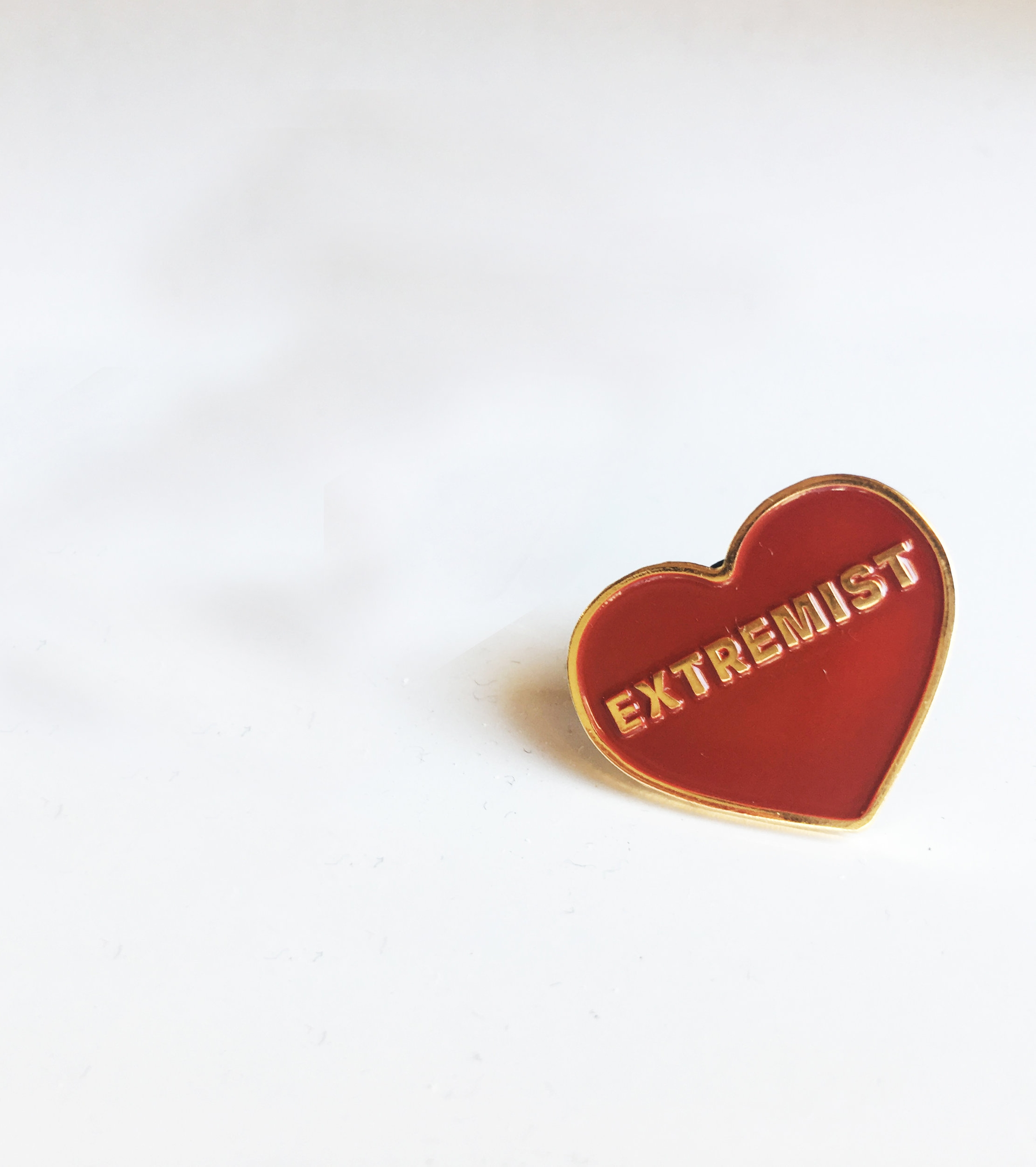 Pins are red and gold soft metal enamel with a hard rubber stopper and the website engraved on the back