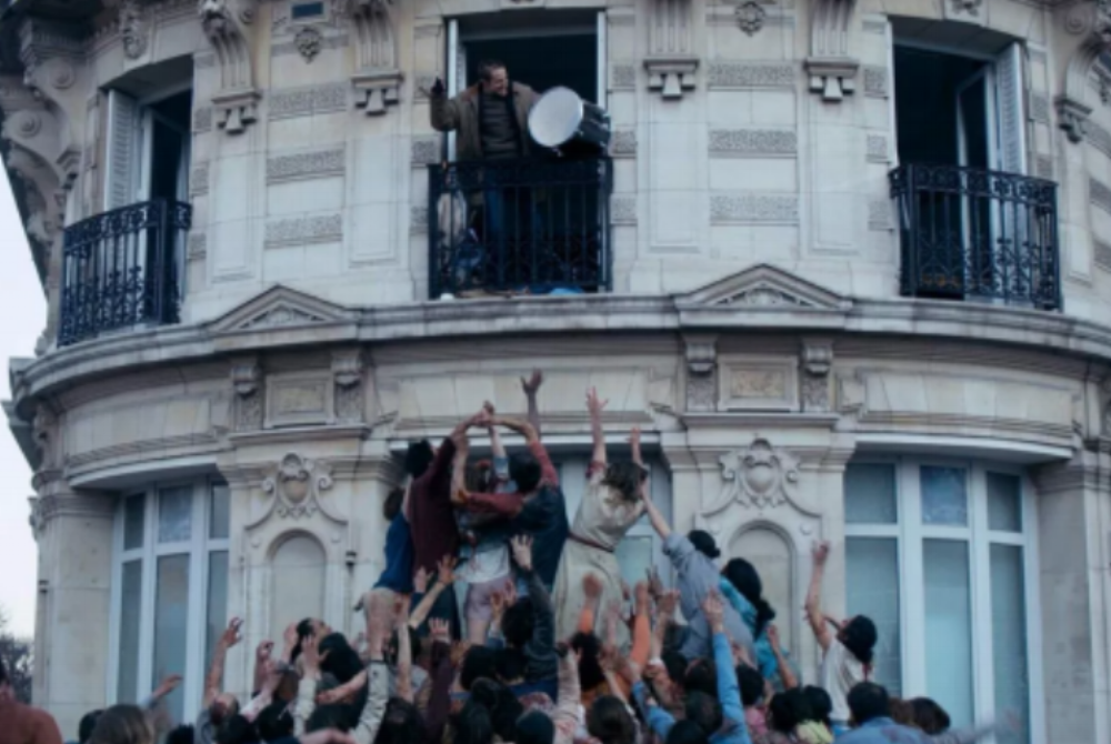 "Sam (Anders Danielsen Lie, top) raises the ire of a horde of zombies in the French-made psychological horror thriller ""The Night Eats the World."" (Photo courtesy Blue Fox Entertainment)"