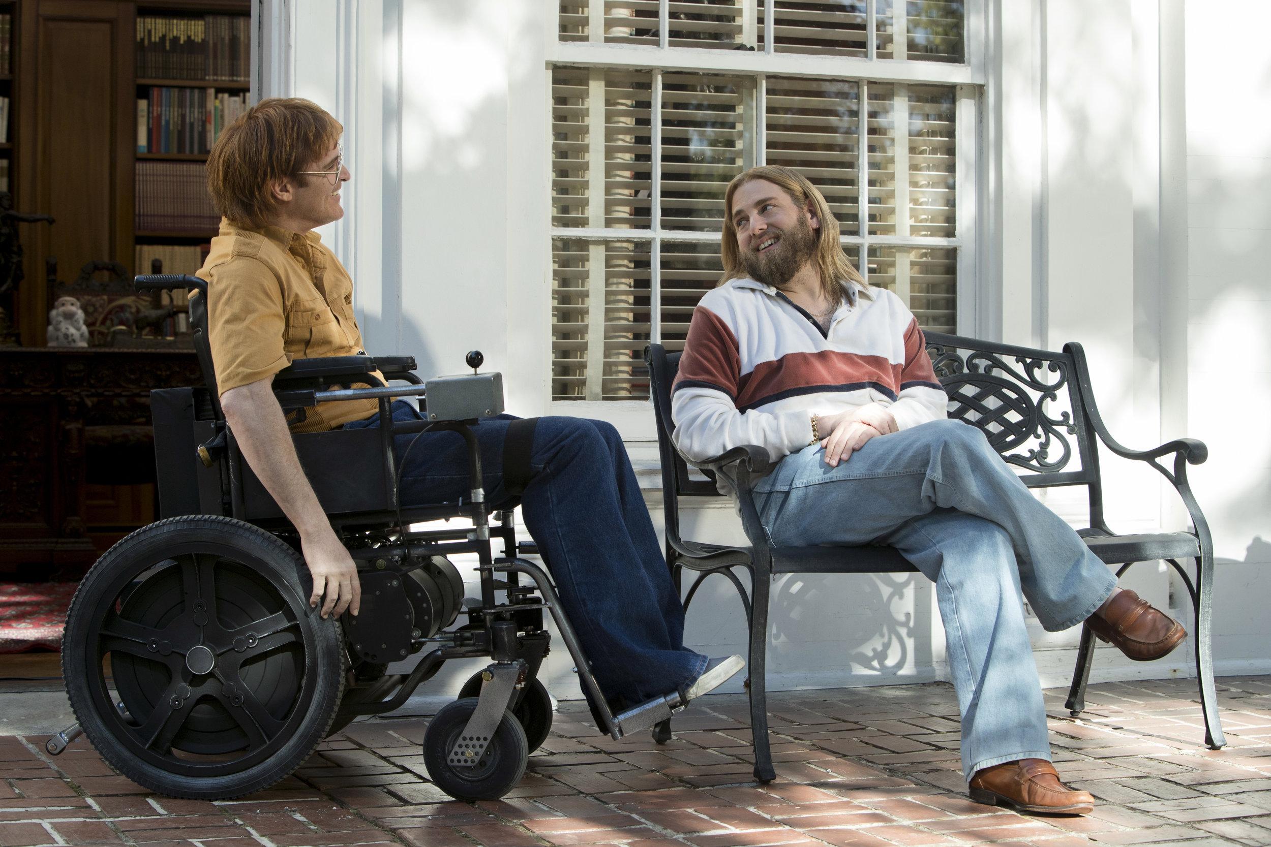 "Cartoonist John Callahan (Joaquin Phoenix, left) talks with his AA sponsor, Donnie (Jonah Hill), in Gus Van Sant's comedy-drama ""Don't Worry, He Won't Get Far on Foot,"" based on Callahan's memoir. (Photo courtesy Amazon Studios)"