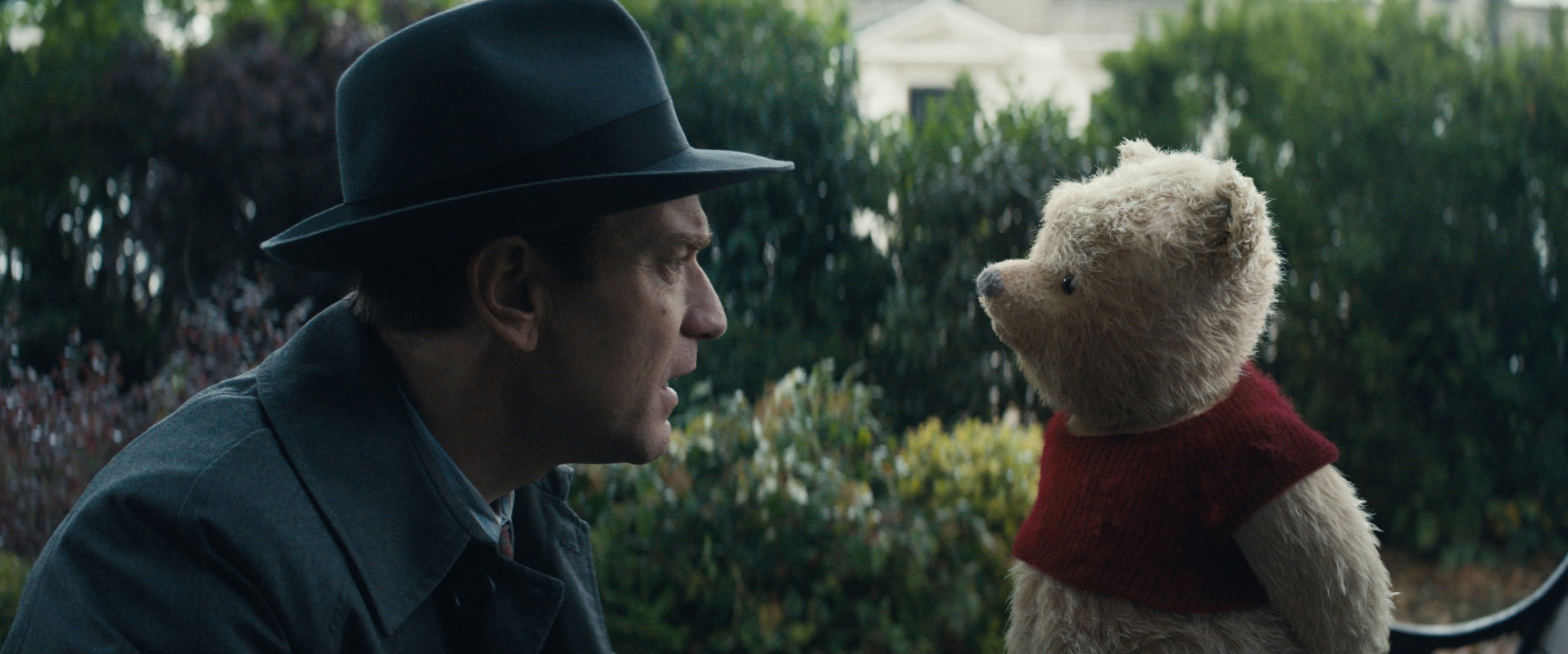 "An adult Christopher Robin (Ewan McGregor) has an unexpected reunion with his childhood friend, Winnie the Pooh, in Disney's live-action adventure ""Christopher Robin."" (Photo courtesy Walt Disney Pictures)"