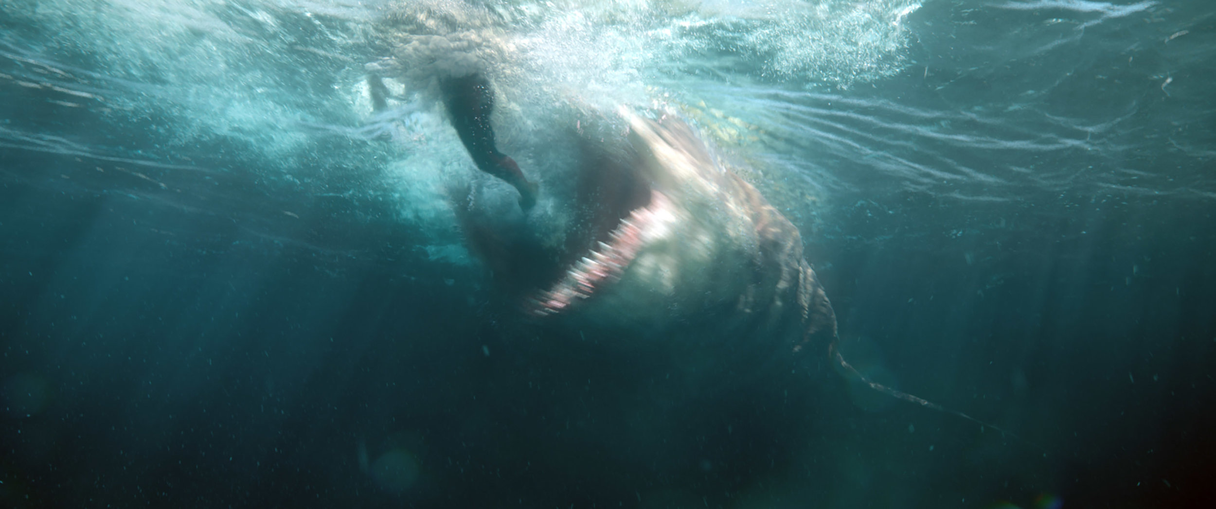 """A megalodon, a super-sized prehistoric shark, goes on the attack in a scene from the ocean thriller """"The Meg."""" (Photo courtesy Warner Bros. Pictures)"""