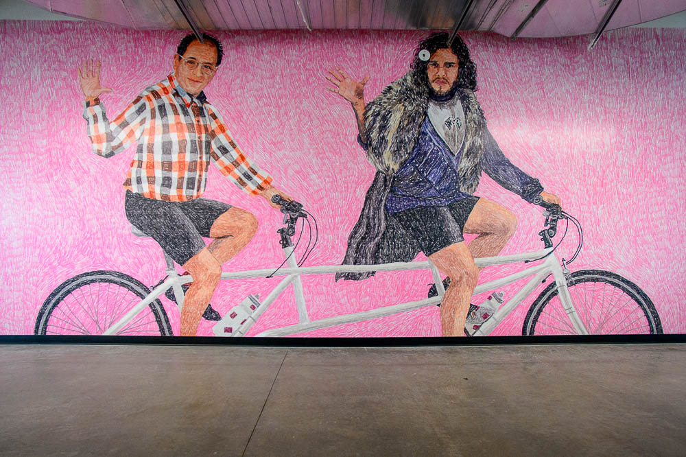 """A mural, by Swedish artist Johanna Burai, of TV characters George Costanza and Jon Snow on a tandem bike is one of the items of """"street art"""" inside the new headquarters for the web development company Podium, in Lehi, Utah. (Photo by Trent Nelson 