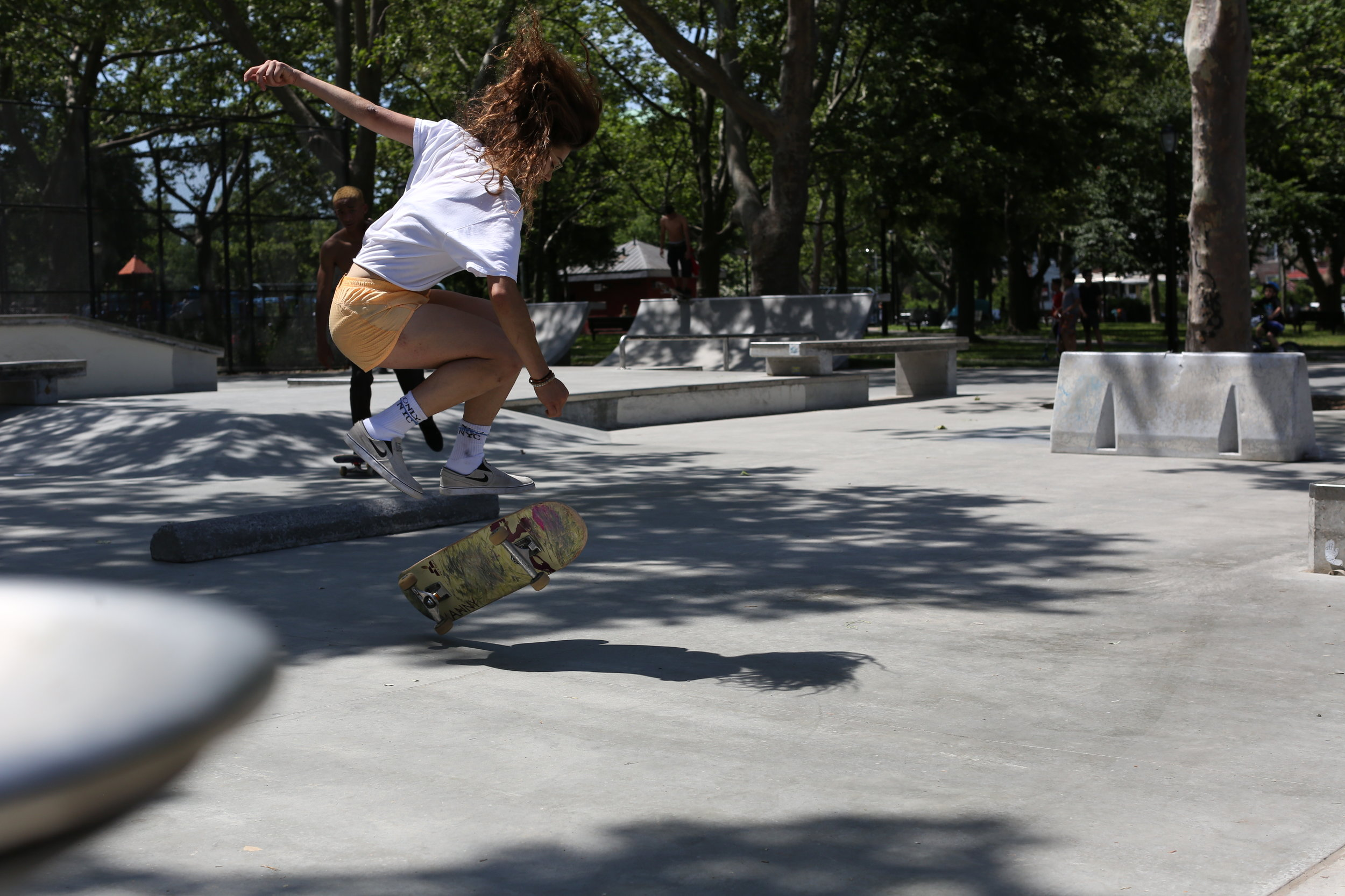 "Camille (Rachelle Vinberg) performs some skateboard tricks in a New York skate park, in a scene from the drama ""Skate Kitchen."" (Photo courtesy Magnolia Pictures)"