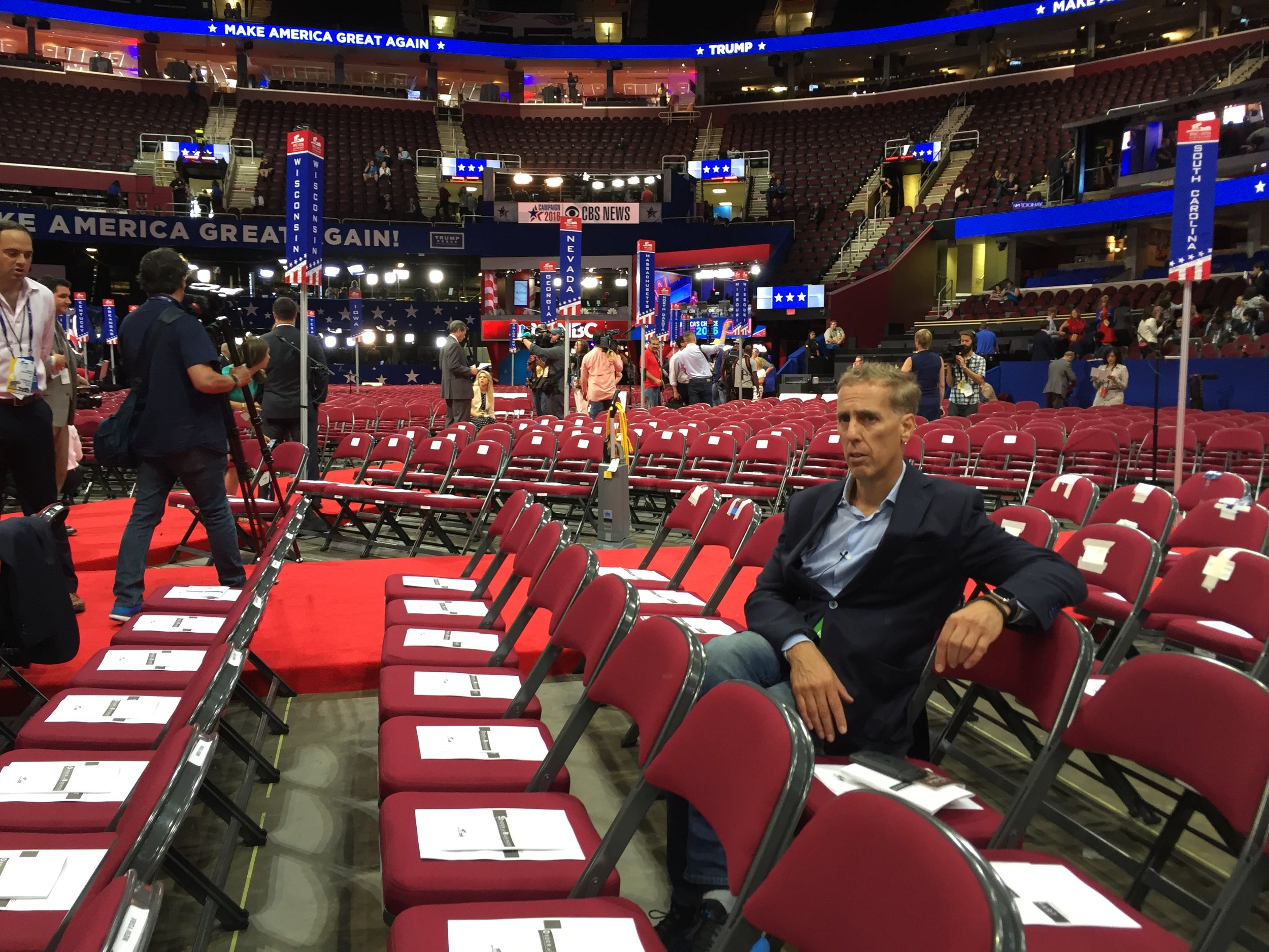 "Movie producer James D. Stern sits in the empty seats at the 2016 Republican National Convention in Cleveland, in a moment from the documentary ""American Chaos,"" which Stern directed. (Photo by Kevin Ford, courtesy of Sony Pictures Classics)"