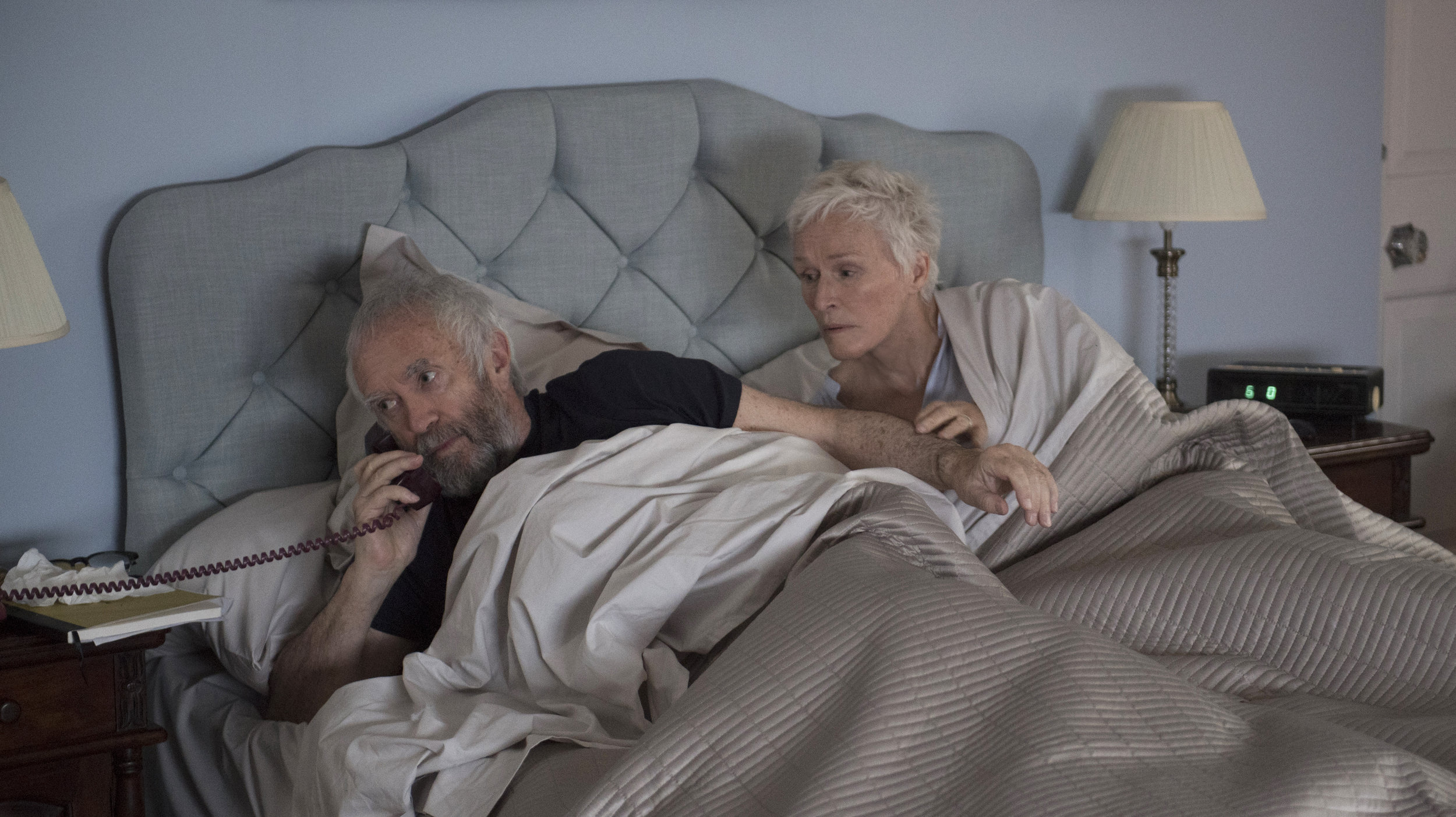 """Joan Castleman (Glenn Close, right) listens as her husband, novelist Joe Castleman (Jonathan Pryce), gets news that he has won the Nobel Prize for Literature, in a scene from the drama """"The Wife."""" (Photo by Graeme Hunter, courtesy of Sony Pictures Classics)"""