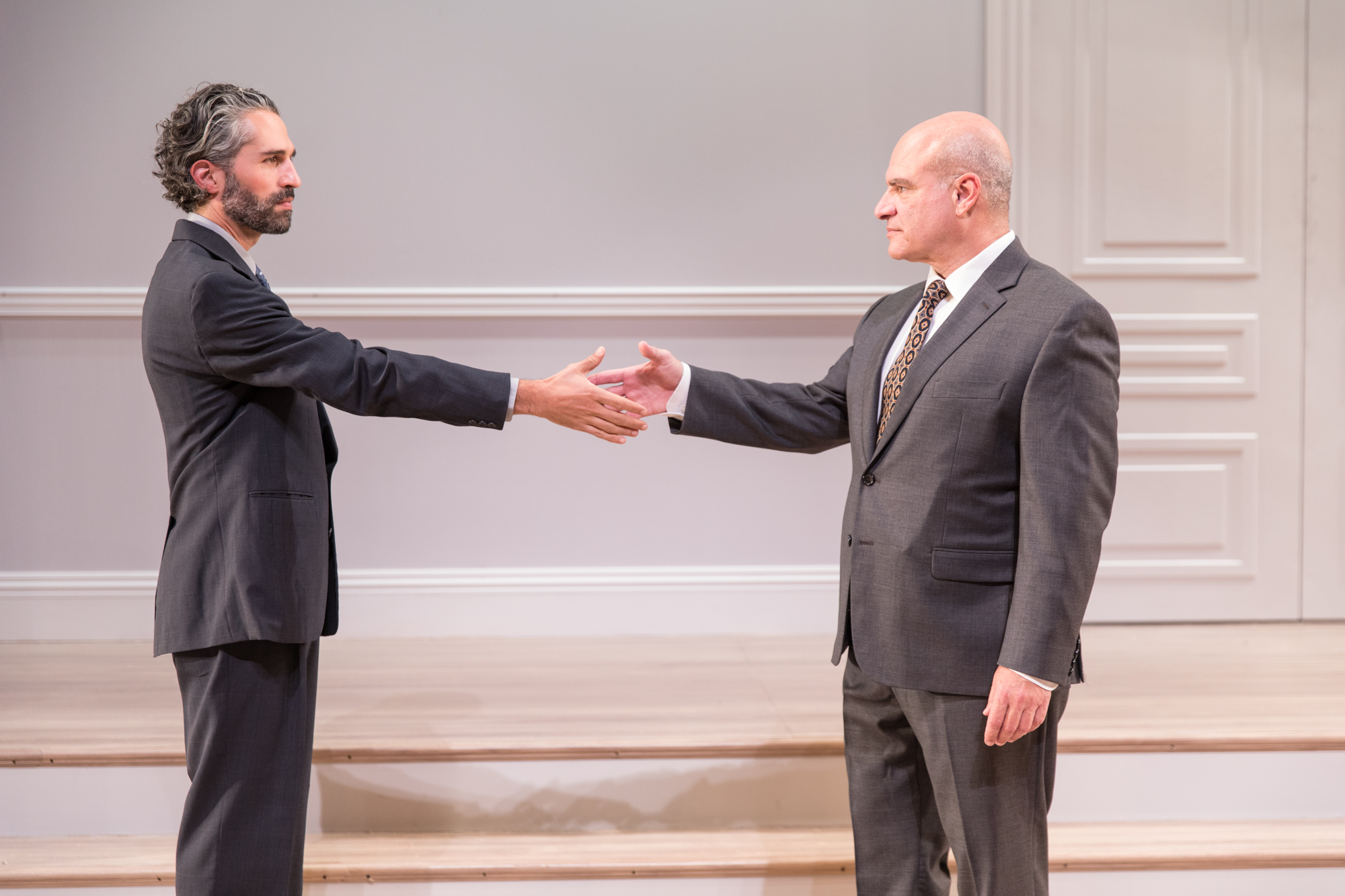 """Israeli diplomat Uri Savir (Ben Cherry, left) makes an agreement with his Palestinian counterpart, Ahmed Qurel (Demosthenes Chrysan), in a scene from Pioneer Theatre Company's production of J.T. Rogers' Tony-winning play """"Oslo."""" The play runs at Pioneer Memorial Theatre from Sept. 14 to 29. (Photo courtesy Pioneer Theatre Company)"""