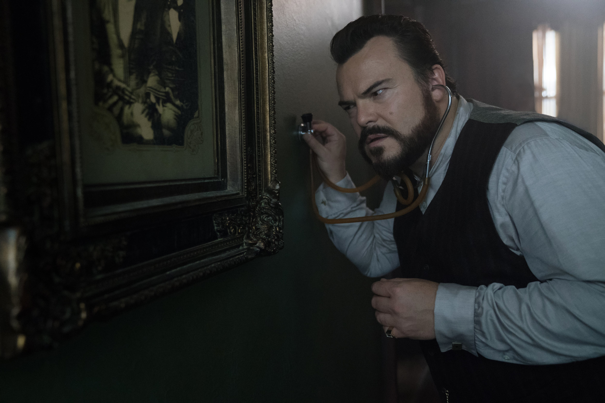 """Jonathan Bardevelt (Jack Black) searches for a telltale clock in the magic suspense tale """"The House With a Clock in Its Walls."""" (Photo courtesy Universal Pictures)"""