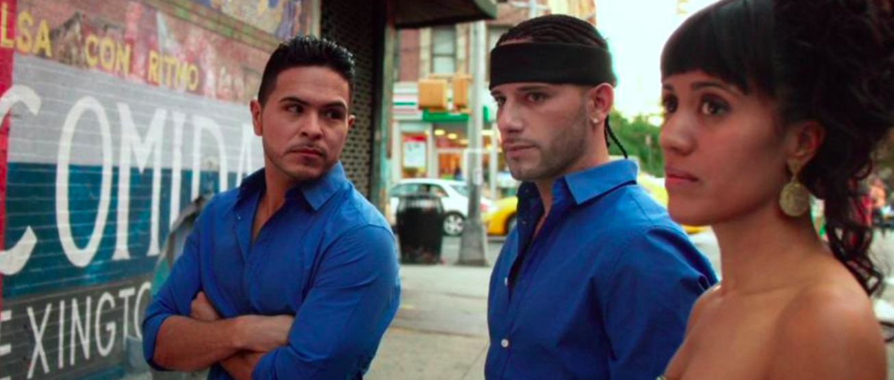 """Brothers Junior (Gilbert Saldivar, left) and Ralphi (Jorge Burgos, center), along with their dancer friend Josie (Kimberli Flores) get a lesson about their Spanish Harlem neighborhood, in the dance-heavy drama """"Shine."""" (Photo courtesy GVN Releasing)"""