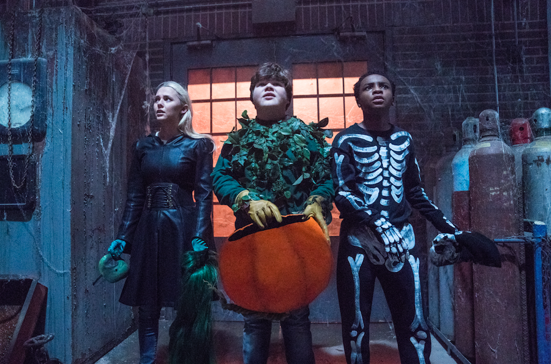 """Sarah (Madison Iseman, left), her brother Sonny (Jeremy Ray Taylor, center) and his friend Sam (Caleel Harris) get set to battle too-real demons in their town in """"Goosebumps 2: Haunted Halloween."""" (Photo by Daniel McFadden, courtesy Columbia Pictures)"""