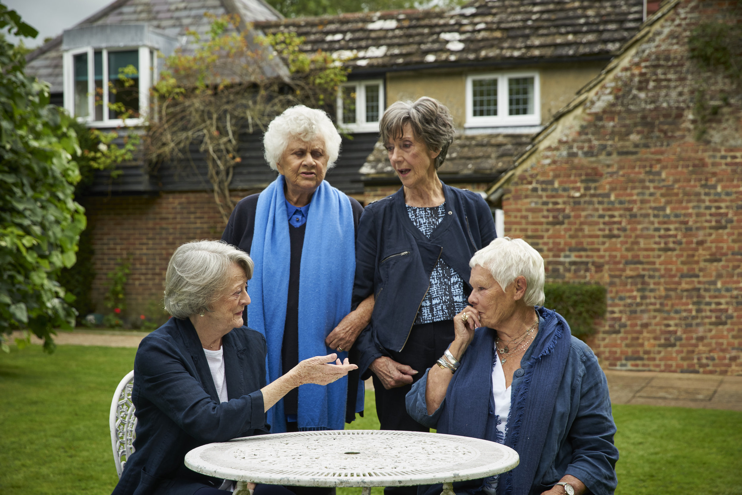 """Four legends of English theater and film — Dame Maggie Smith, Dame Joan Plowright, Dame Eileen Atkins and Dame Judi Dench (clockwise from lower left) — dish in the documentary """"Tea With the Dames."""" (Photo courtesy Sundance Selects)"""