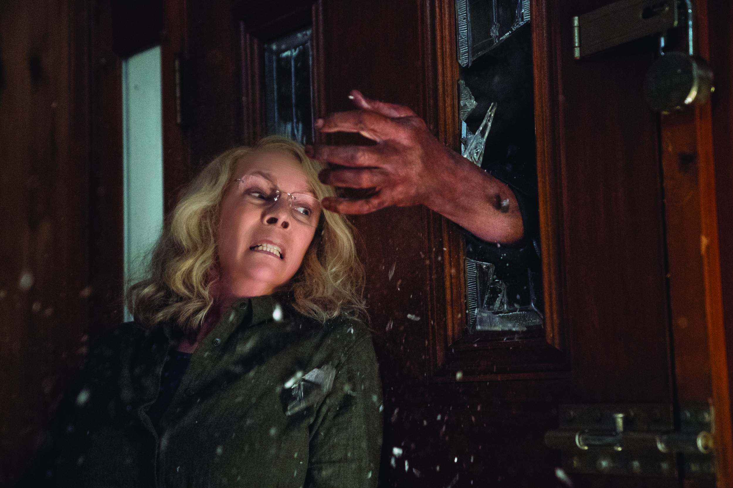 """Laurie Strode (Jamie Lee Curtis) fights off Michael Myers once again in """"Halloween,"""" a continuation of the story begun in John Carpenter's 1978 horror classic. (Photo by Ryan Green, courtesy Universal Pictures)"""