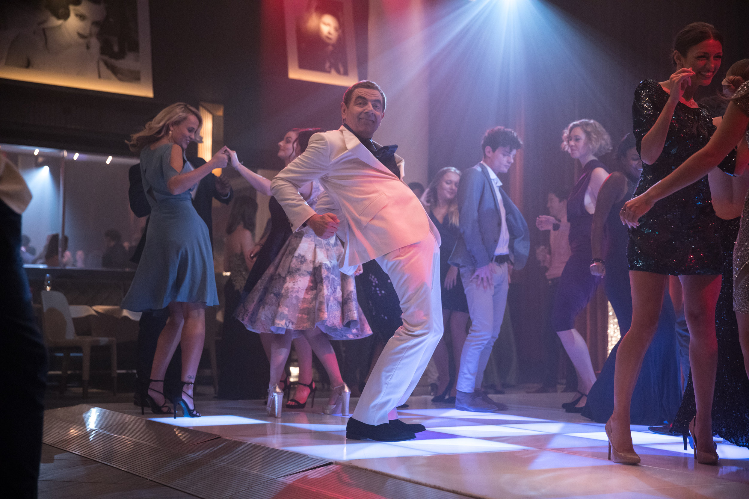 "Super-spy Johnny English (Rowan Atkinson) hits the dance floor in the comedy ""Johnny English Strikes Again."" (Photo by Giles Keyte, courtesy Focus Features)"