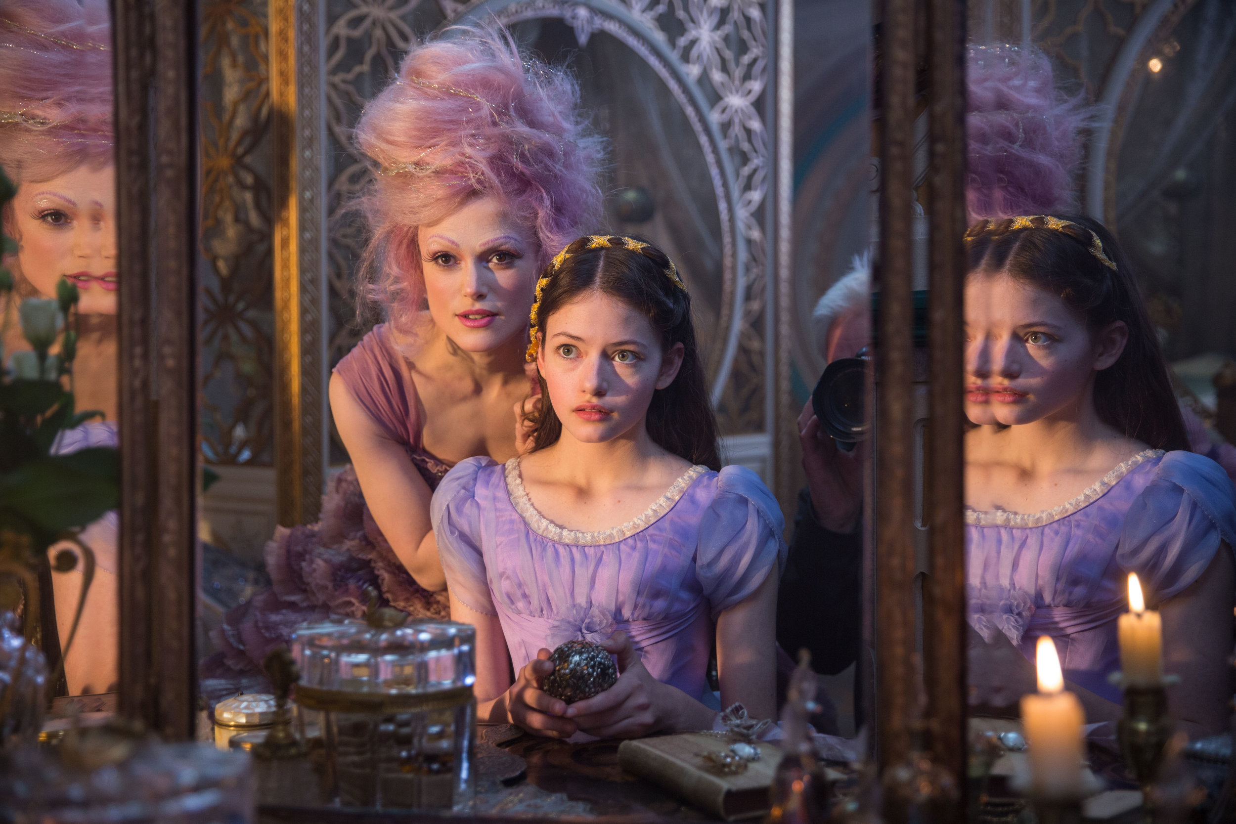 "The Sugar Plum Fairy (Keira Knightley, left) helps give a makeover to Clara (Mackenzie Foy), who has landed in a magical land, in Disney's ""The Nutcracker and the Four Realms,"" a movie adaptation of the Christmas classic. (Photo courtesy Walt Disney Pictures)"