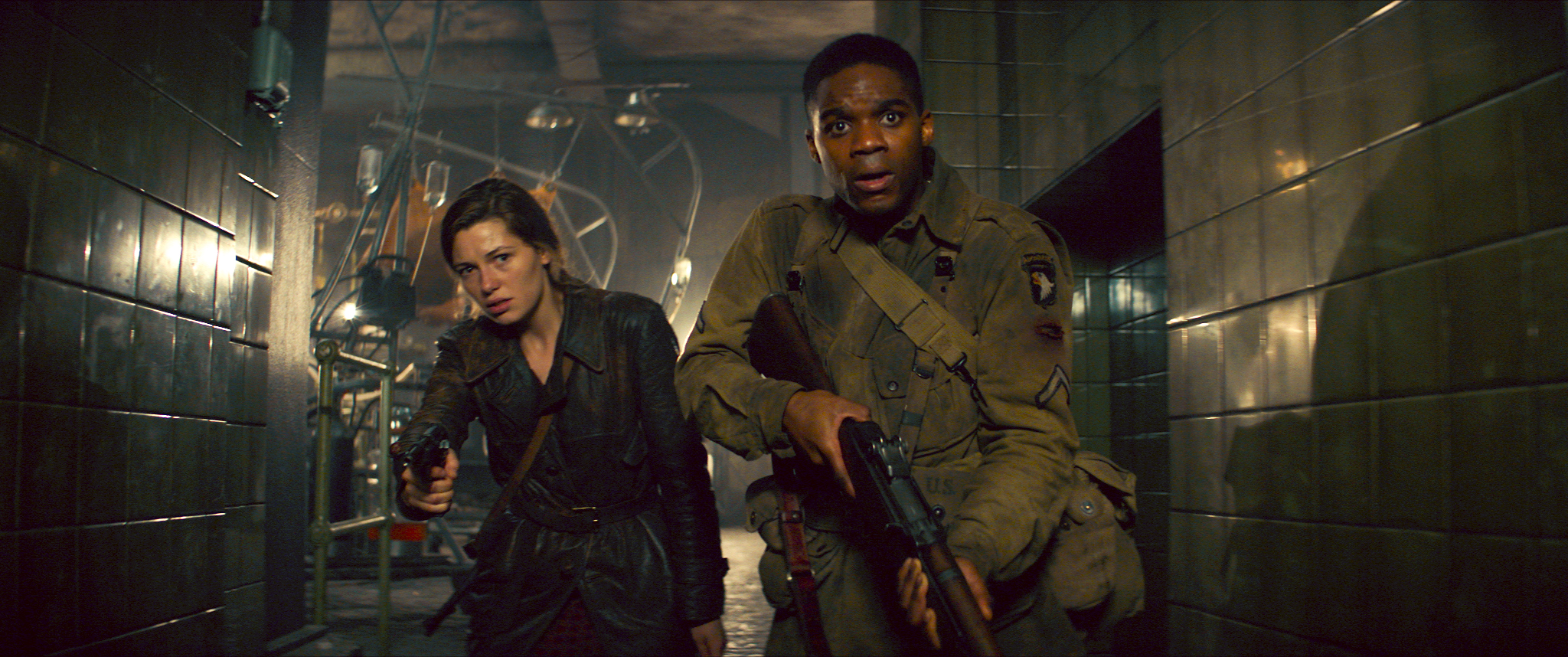 """American paratrooper Ed Boyce (Jovan Apero, right) and Frenchwoman Chloe (Mathilde Ollivier) get inside a secret German base on the cusp of D-Day, and discover something truly monstrous, in the World War II horror-thriller """"Overlord."""" (Photo courtesy Paramount Pictures)"""