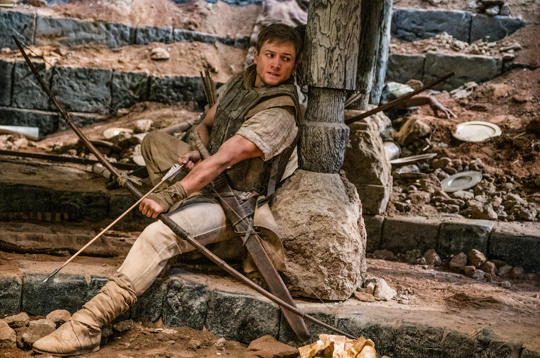 """Robin of Loxley (Taron Egerton) fights in the Crusades, in a scene from """"Robin Hood."""" (Photo courtesy Summit Entertainment / Lionsgate)"""