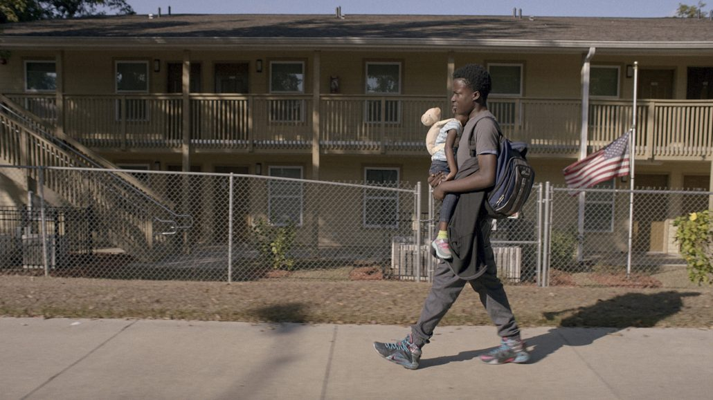 "Andrew, a troubled African-American teen, carries his 3-year-old sister Nesie (Ry'nesia Chambers) on a long walk home, in the cinema verité drama ""Life and Nothing More."" (Photo courtesy CFI Releasing)"