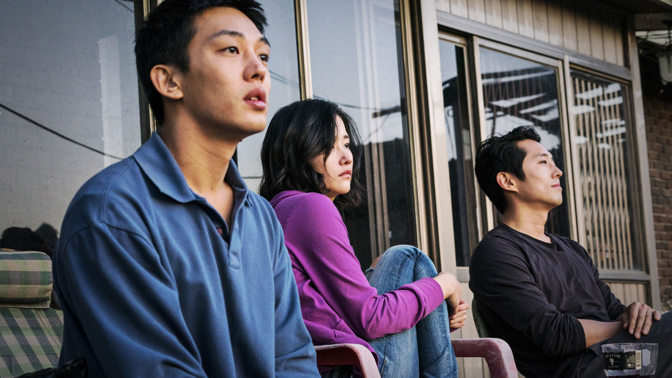 "Jong-su (Yoo Ah-in, left) falls in love with Hae-mi (Jeon Jong-Seo, center), and becomes jealous of her new friend Ben (Steven Yeun), in Lee Chang-dong's Korean noir thriller ""Burning."""