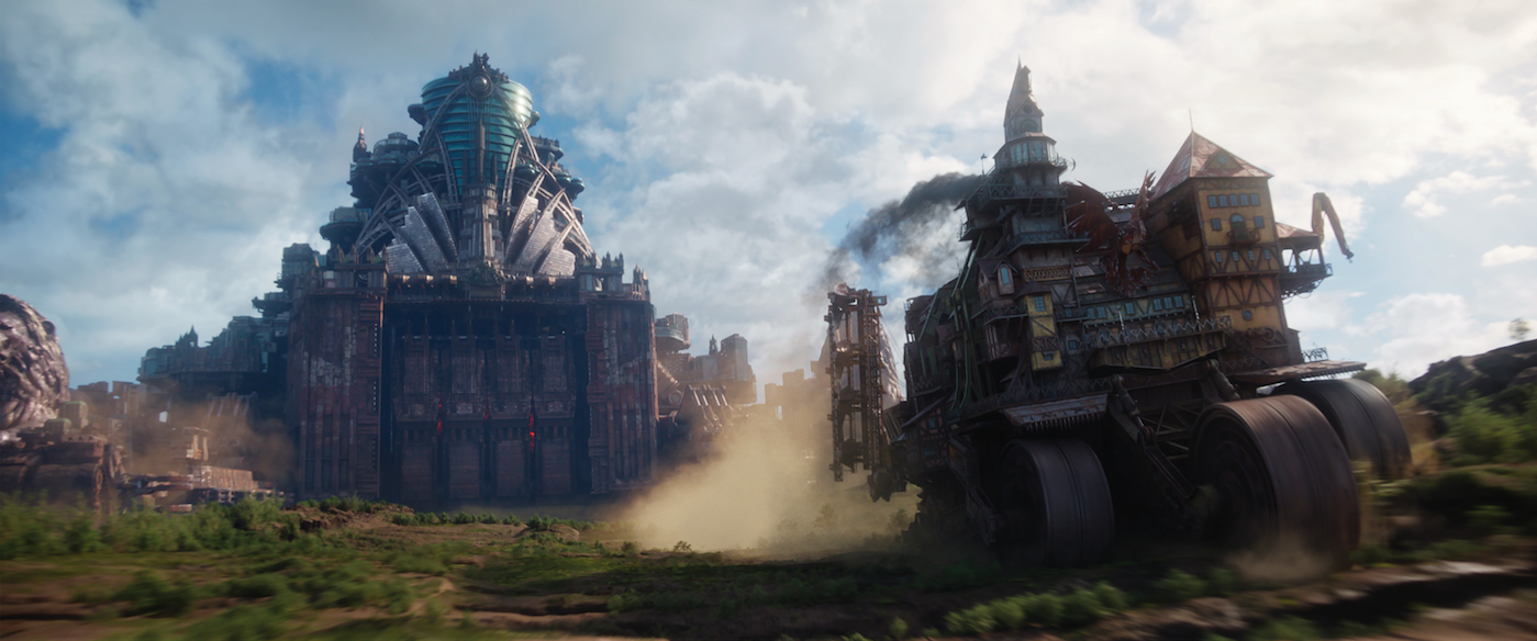 """A giant mobile London, left, bears down on a smaller mobile city, in a scene from the dystopian action movie """"Mortal Engines."""" (Photo courtesy Universal Pictures)"""