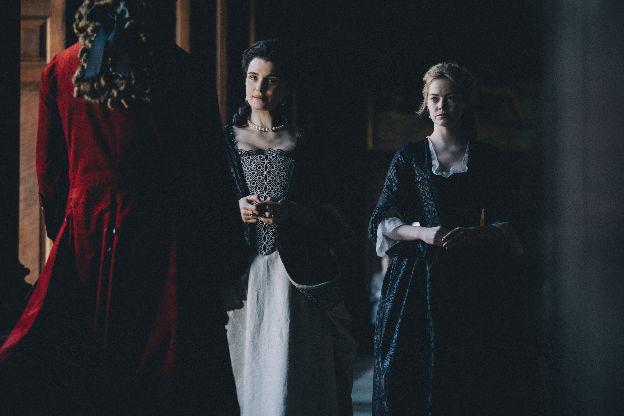 "The Duchess of Marlborough, Sarah Churchill (Rachel Weisz, center) and her cousin, lady-in-waiting Abigail Hill (Emma Stone, right) greet the handsome Samuel Mesham (Joe Alwyn), in a scene from ""The Favourite."" (Photo courtesy Fox Searchlight Pictures)"