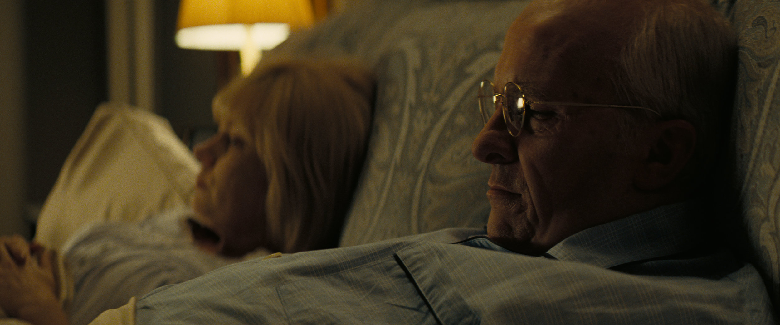 "Dick Cheney (Christian Bale, right) and his wife Lynne (Amy Adams) lie in bed, in a scene from Adam McKay's biographical drama ""Vice."" (Photo courtesy Annapurna Pictures)"