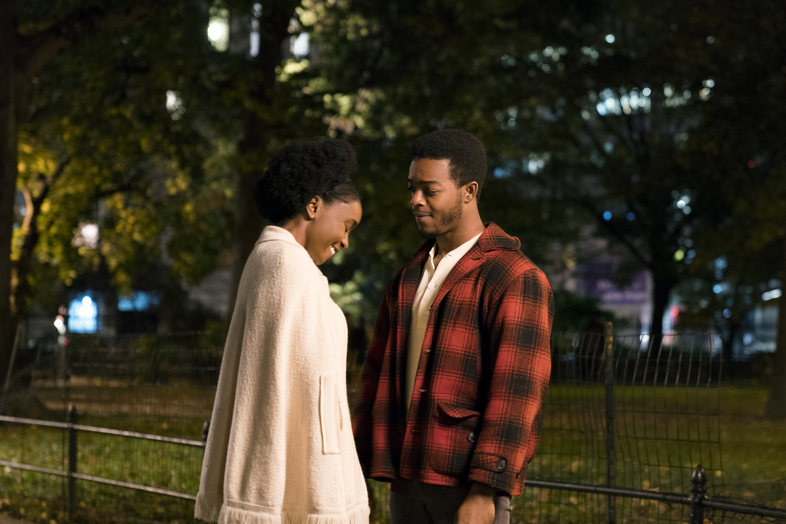 """Tish (Kiki Layne, left) and Fonny (Stephan James) are young and in love in 1970s Harlem, in writer-director Barry Jenkins' """"If Beale Street Could Talk,"""" an adaptation of James Baldwin's novel. (Photo by Tatum Mangus, courtesy Annapurna Pictures)"""