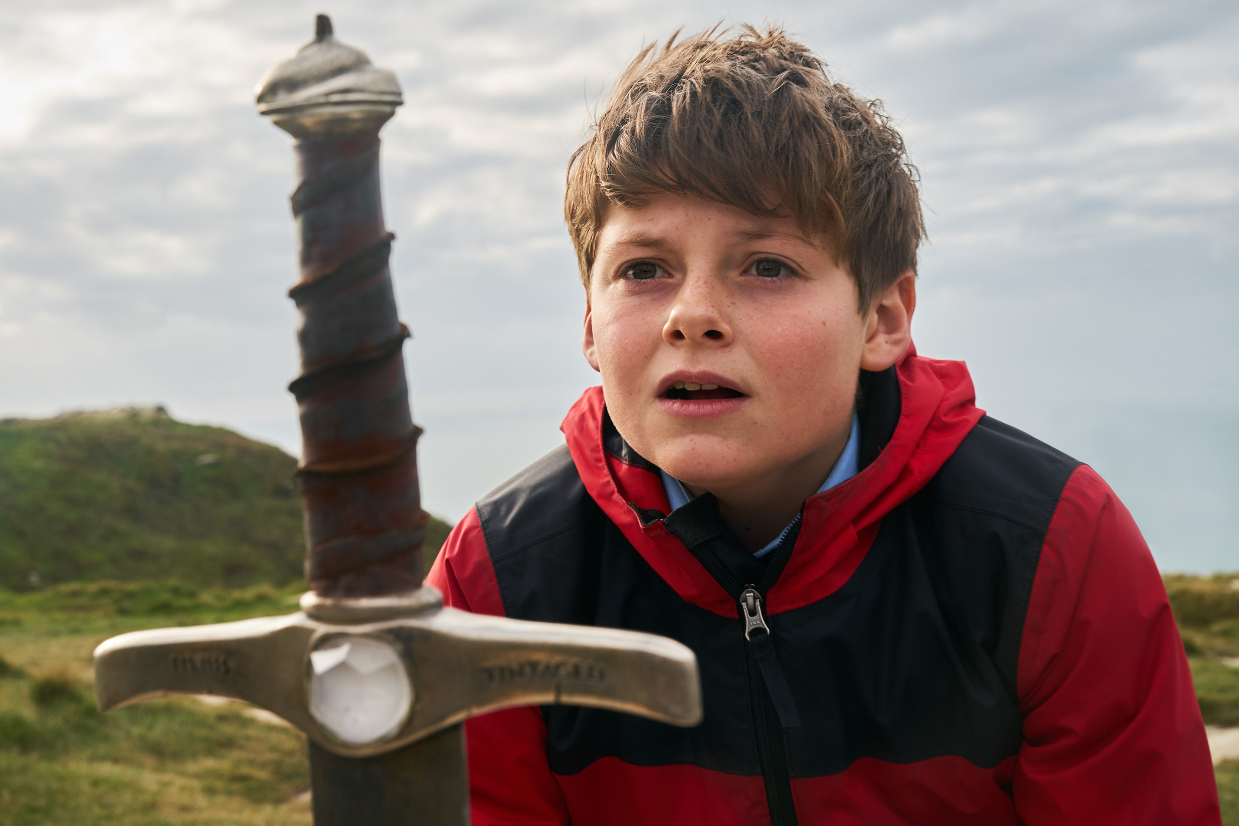 """Alex (Louis Ashbourne Serkis), a 12-year-old London lad, becomes the holder of Excalibur in the adventure """"The Kid Who Would Be King."""" (Photo by Kerry Brown, courtesy 20th Century Fox)"""