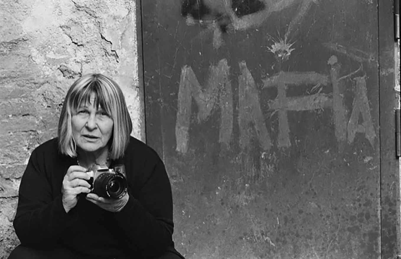 "Photographer Letizia Battaglia, who for decades has captured life in Sicily, including mob violence, is the subject of Kim Longinotto's ""Shooting the Mafia,"" an official selection in the World Cinema Documentary Competition of the 2019 Sundance Film Festival. (Photo courtesy Sundance Institute)"