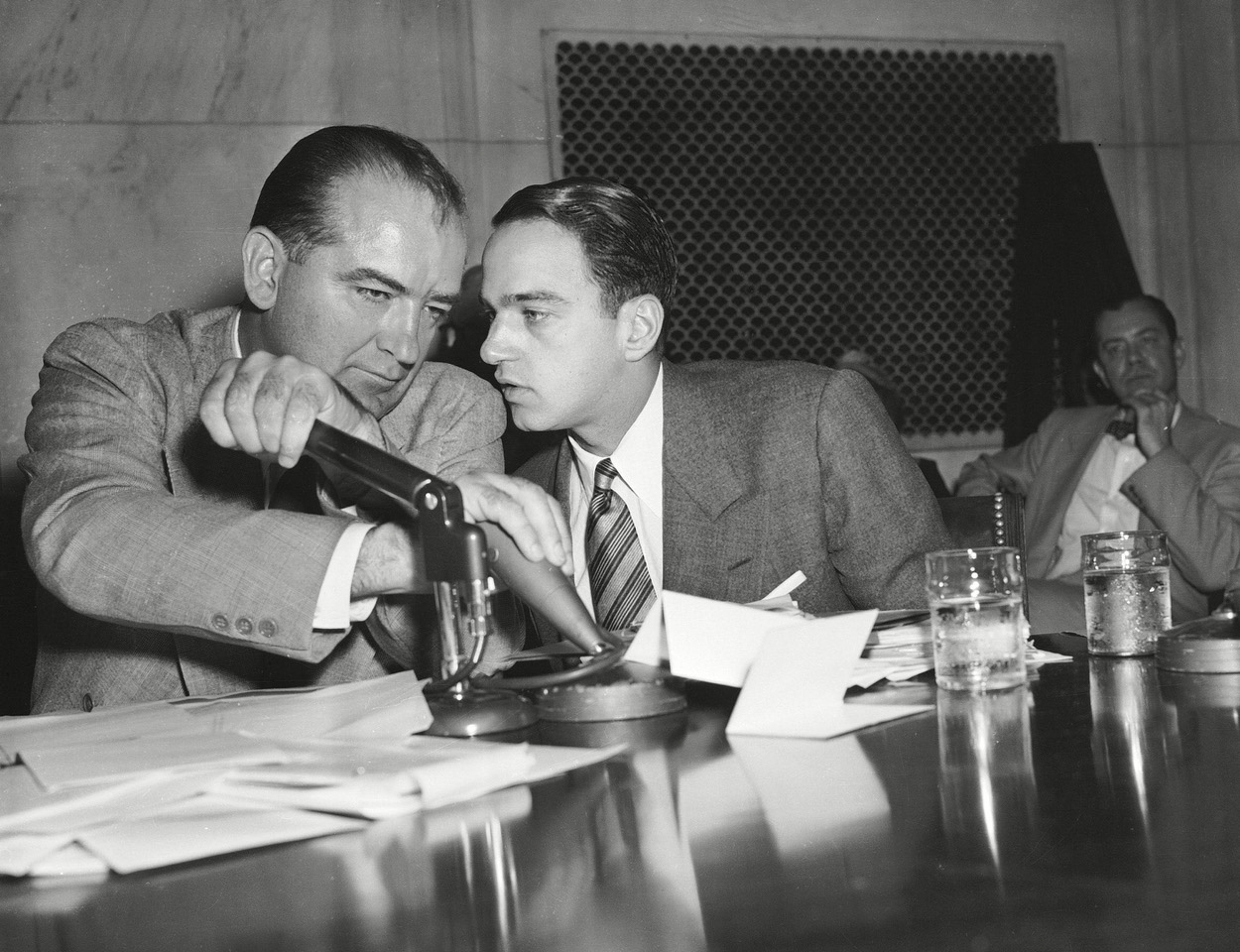 "Attorney Roy Cohn, right, whispers in the ear of red-baiting Sen. Joseph McCarthy, in an image from Matt Tyrnauer's ""Where's My Roy Cohn?"", an official selection in the U.S. Documentary Competition of the 2019 Sundance Film Festival. (AP/REX/Shuttersock 