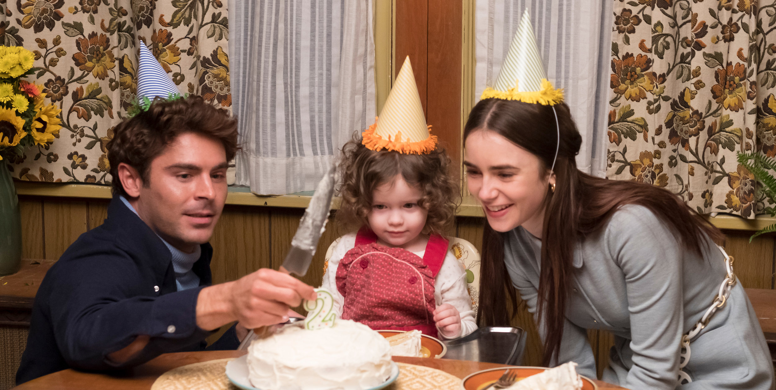 "Zac Efron, left, portrays serial killer Ted Bundy, here with his unsuspecting girlfriend Liz Kloepfer (Lily Collins, right) and her daughter (Macie Carmosino), in Joe Berlinger's ""Extremely Wicked, Shockingly Evil and Vile,"" an official selection in the Premieres program of the 2019 Sundance Film Festival. (Photo by Brian Douglas, courtesy Sundance Institute)"