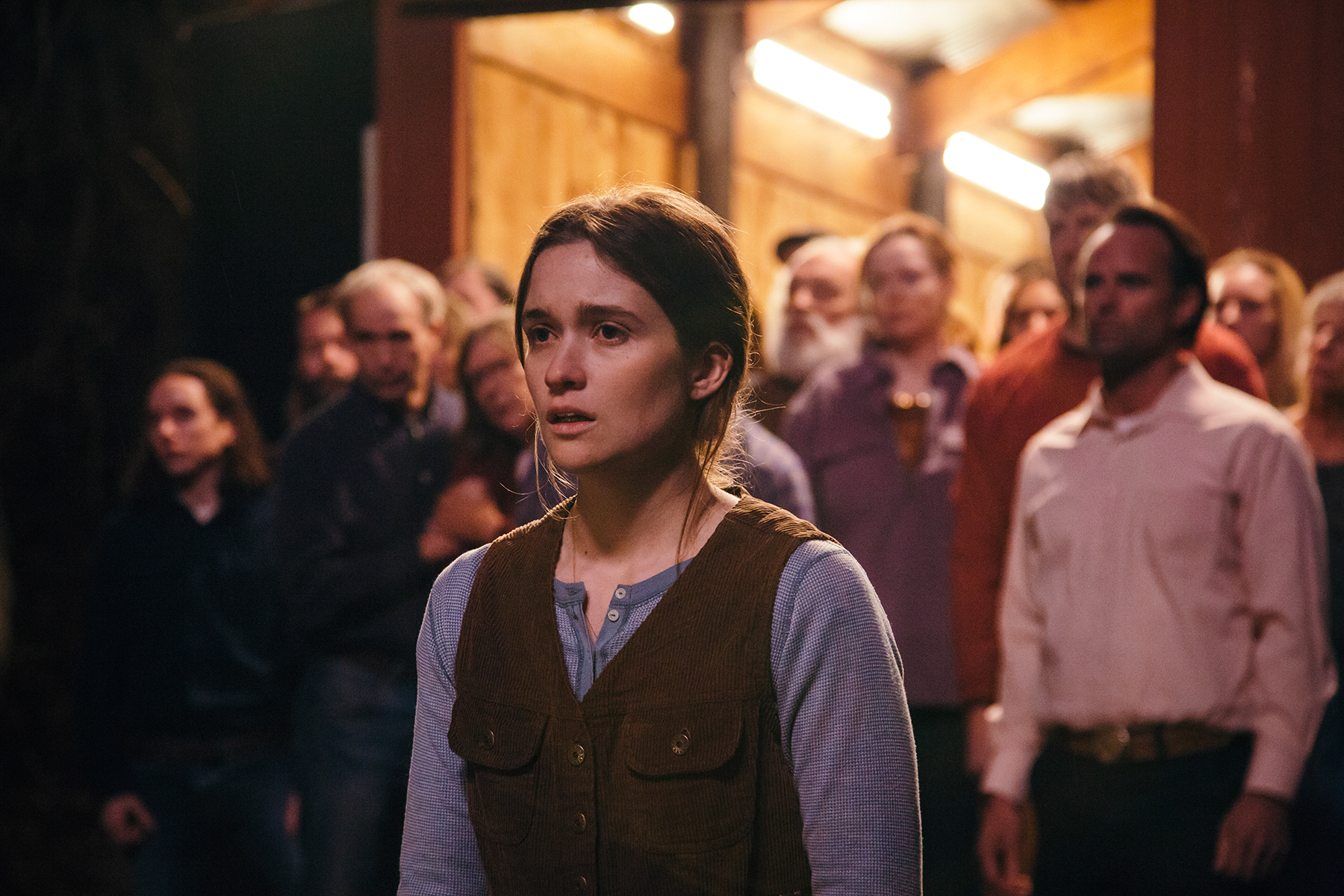 """Alice Englert, center, plays Maura, dutiful daughter of Lemuel (Walton Goggins, right), the pastor in a church that believes in snake handling, in """"Them That Follow,"""" an official selection in the U.S. Dramatic Competition of the 2019 Sundance Film Festival. (Photo by Julius Chiu, courtesy Sundance Institute)"""