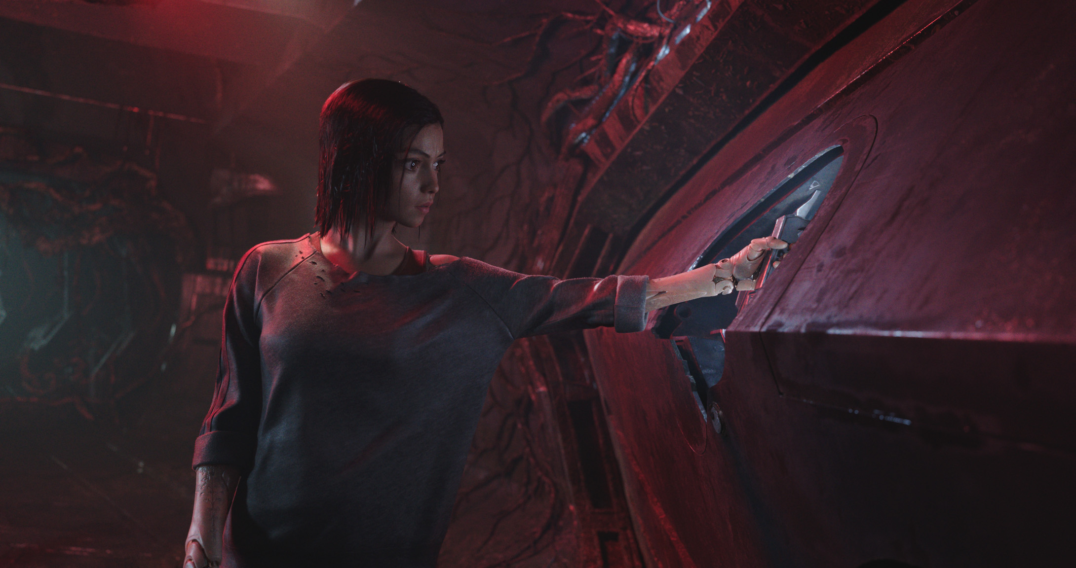 """The cyborg Alita (performed by Rosa Salazar) makes an important discovery in a scene from Robert Rodriguez' science-fiction adventure """"Alita: Battle Angel."""" (Photo courtesy 20th Century Fox)"""