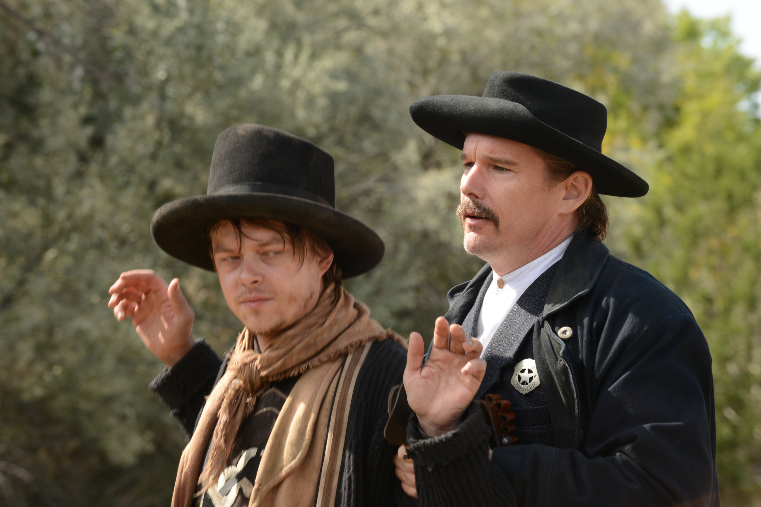 "William Bonney (Dane DeHaan, left), a k a Billy the Kid, surrenders to Pat Garrett (Ethan Hawke), the lawman who has pursued him for years, in the Western drama ""The Kid."" (Photo courtesy Lionsgate)"