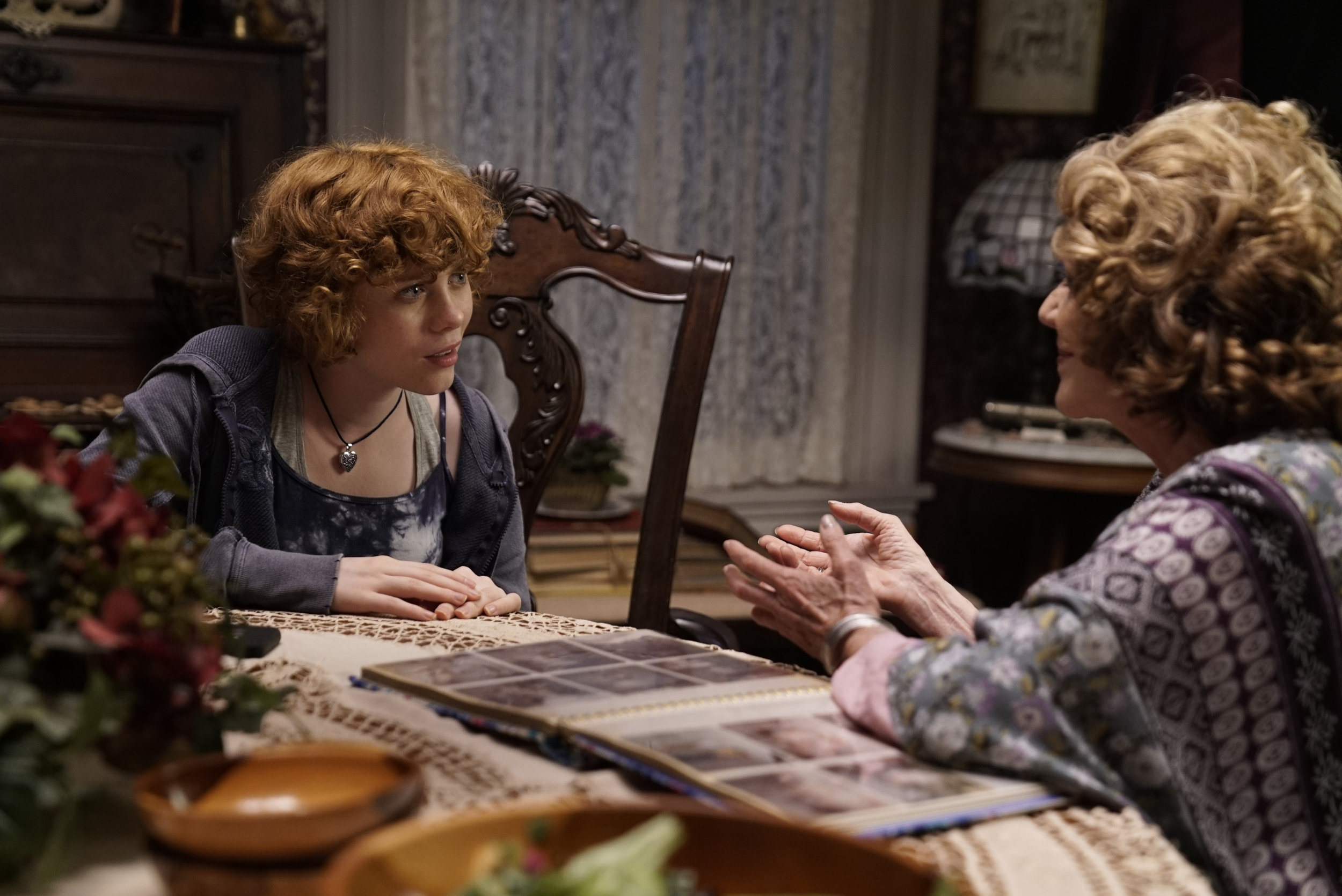 """Nancy Drew (Sophia Lillis, left) learns about the history of an old, and possibly haunted, house from Flora (Linda Lavin), in a scene from """"Nancy Drew and the Hidden Staircase."""" (Photo courtesy Warner Bros. Pictures)"""