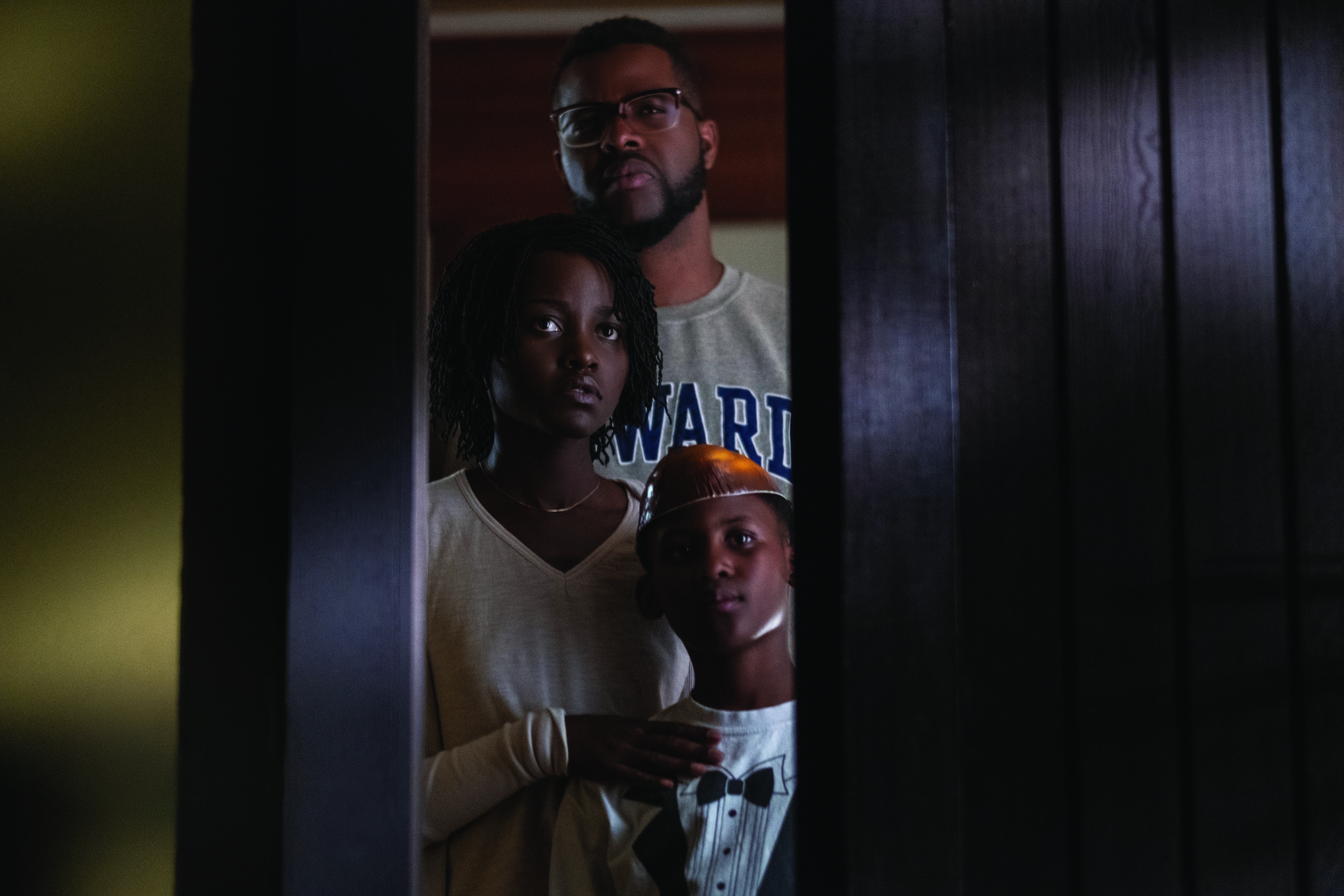 "Gabe Wilson (Winston Duke, top), his wife Adelaide (Lupita Nyong'o, center) and their son Jason (Evan Alex) watch something scary approaching, in Jordan Peele's horror thriller ""Us."" (Photo by Claudette Barius, courtesy of Universal Pictures)"