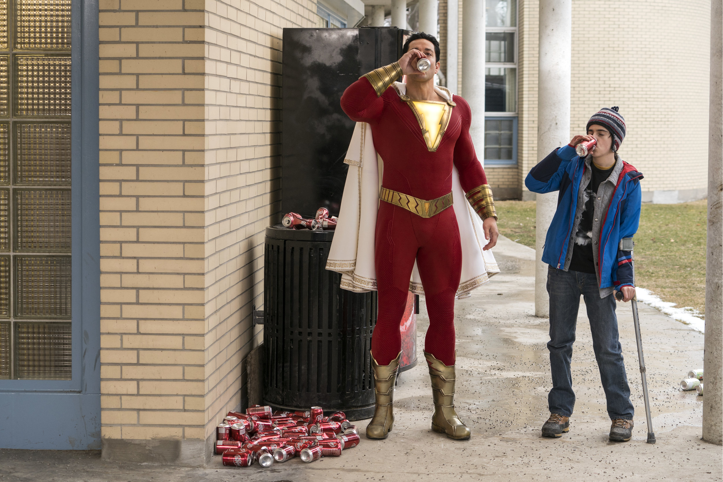 "Superhero Shazam (Zachary Levi, left) and pal Freddy Freeman (Jack Dylan Grazer) have some soda in ""Shazam!,"" based on the DC Comics hero. (Photo by Steve Wilkie, courtesy of DC Comics/New Line Cinema/Warner Bros. Pictures)"