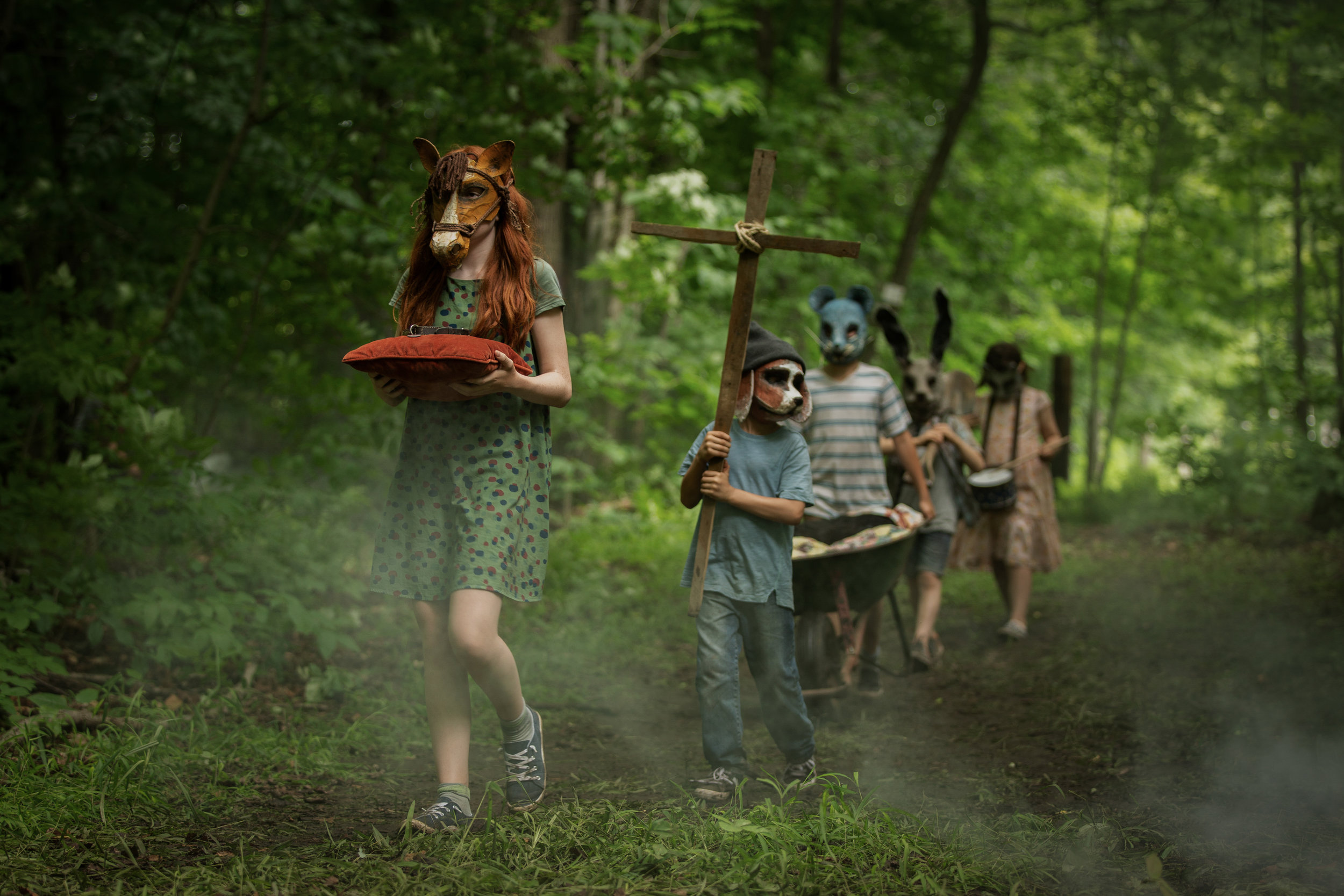 "Children gather for a ritual in the woods in ""Pet Sematary,"" an adaptation of the Stephen King horror novel. (Photo courtesy Paramount Pictures)"