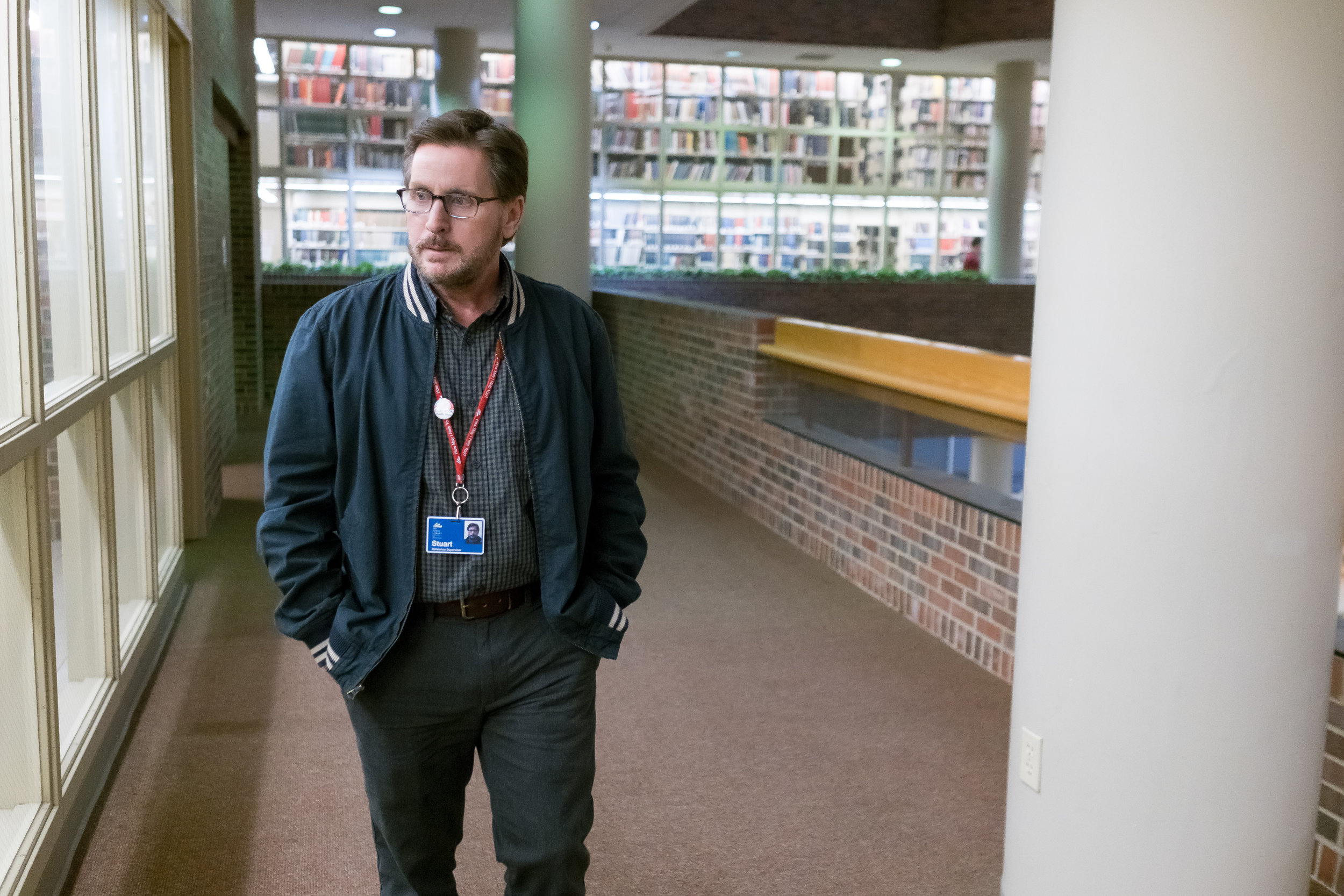 "Emilio Estevez plays Stuart Goodson, a librarian who struggles to handle the challenges brought by having homeless people as patrons, in the drama ""The Public,"" which Estevez wrote and directed. (Photo courtesy Greenwich Entertainment)"