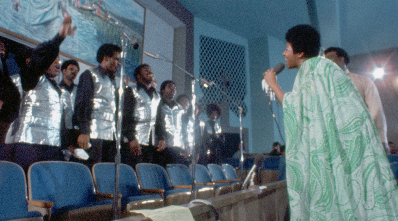 """Aretha Franklin, right, sings a call-and-response with the Southern California Community Choir, during the January 1972 recording of her gospel album """"Amazing Grace,"""" a moment captured in the documentary """"Amazing Grace."""" (Photo courtesy Neon Films.)"""