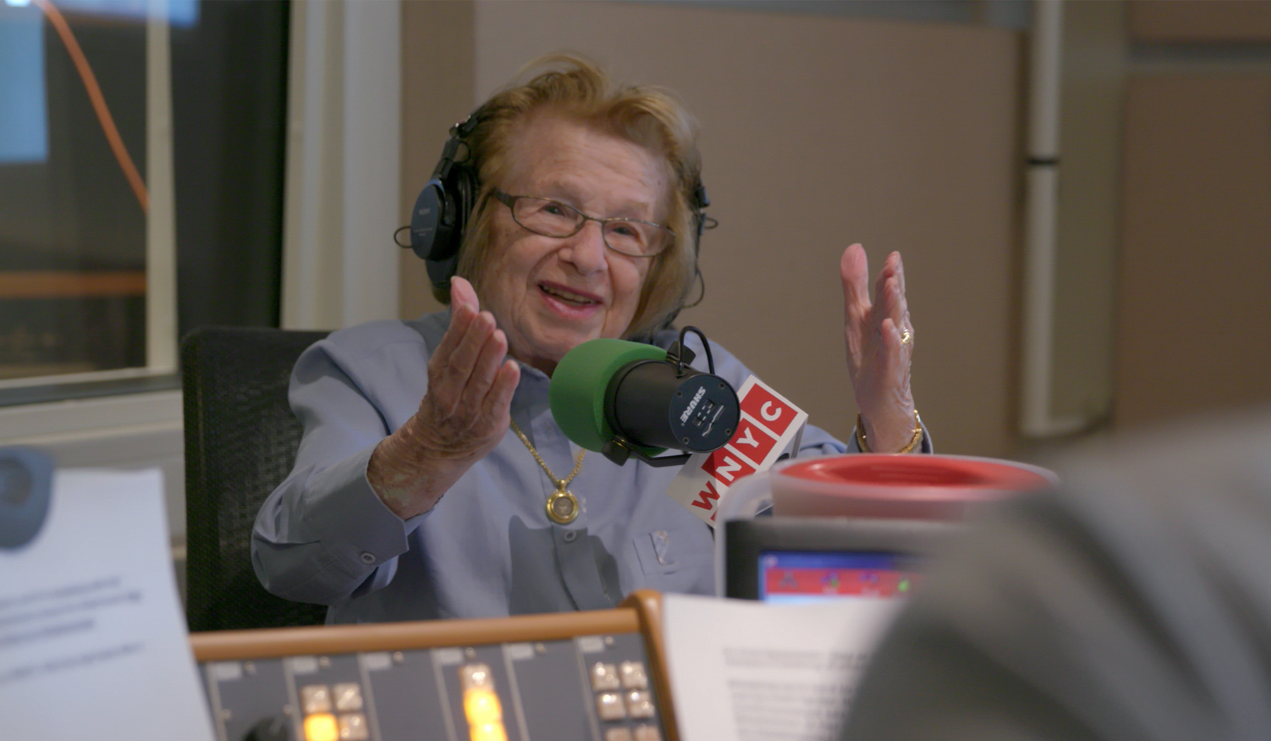 "Dr. Ruth Westheimer appears on WNYC radio in a moment from the documentary ""Ask. Dr. Ruth."" (Photo courtesy Magnolia Pictures / Hulu.)"