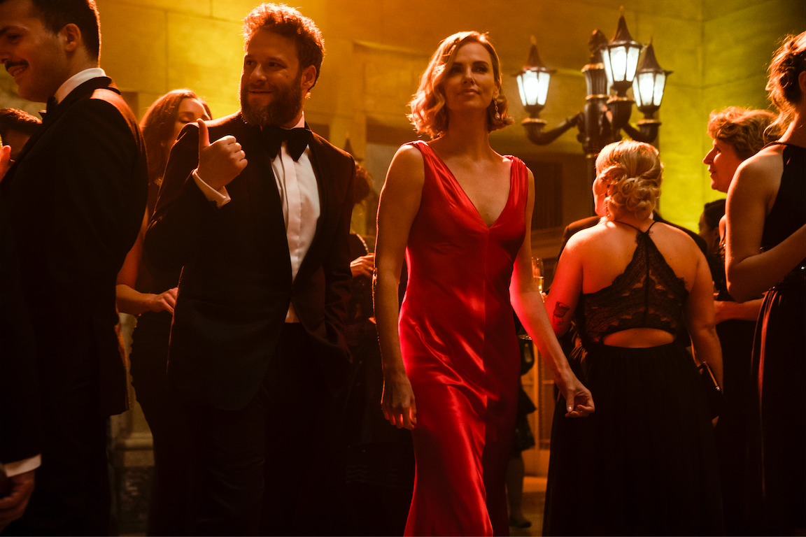 "Journalist-turned-speechwriter Fred Flarsky (Seth Rogen, left) accompanies Secretary of State Charlotte Field (Charlize Theron) to a diplomatic event in the romantic comedy ""Long Shot."" (Photo by Murray Close, courtesy Summit Entertainment / Lionsgate.)"