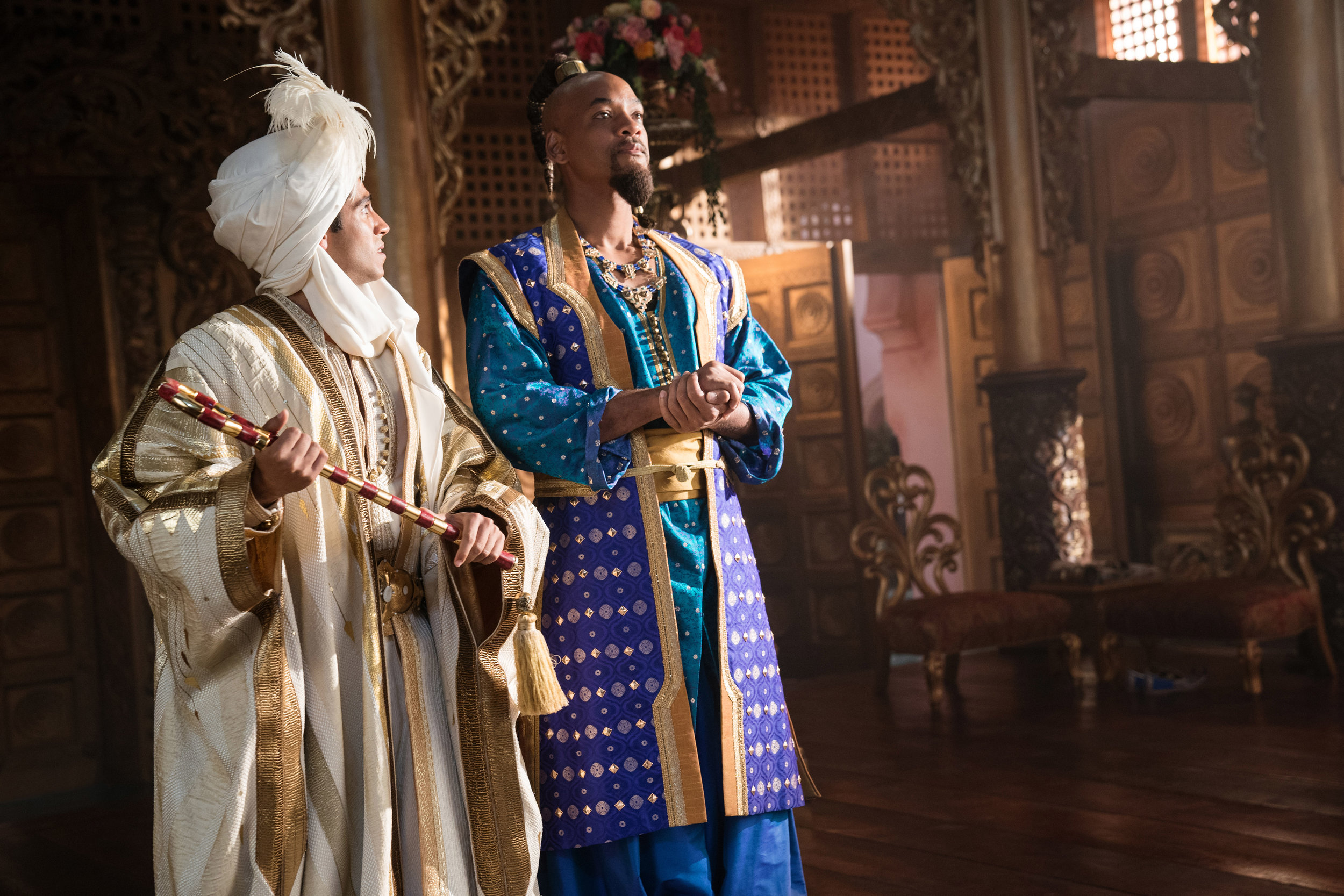 """Aladdin (Mena Massour, left), in his disguise as Prince Ali, gets advice from Genie (Will Smith), in a scene from Disney's live-action remake of """"Aladdin."""" (Photo courtesy Walt Disney Pictures.)"""