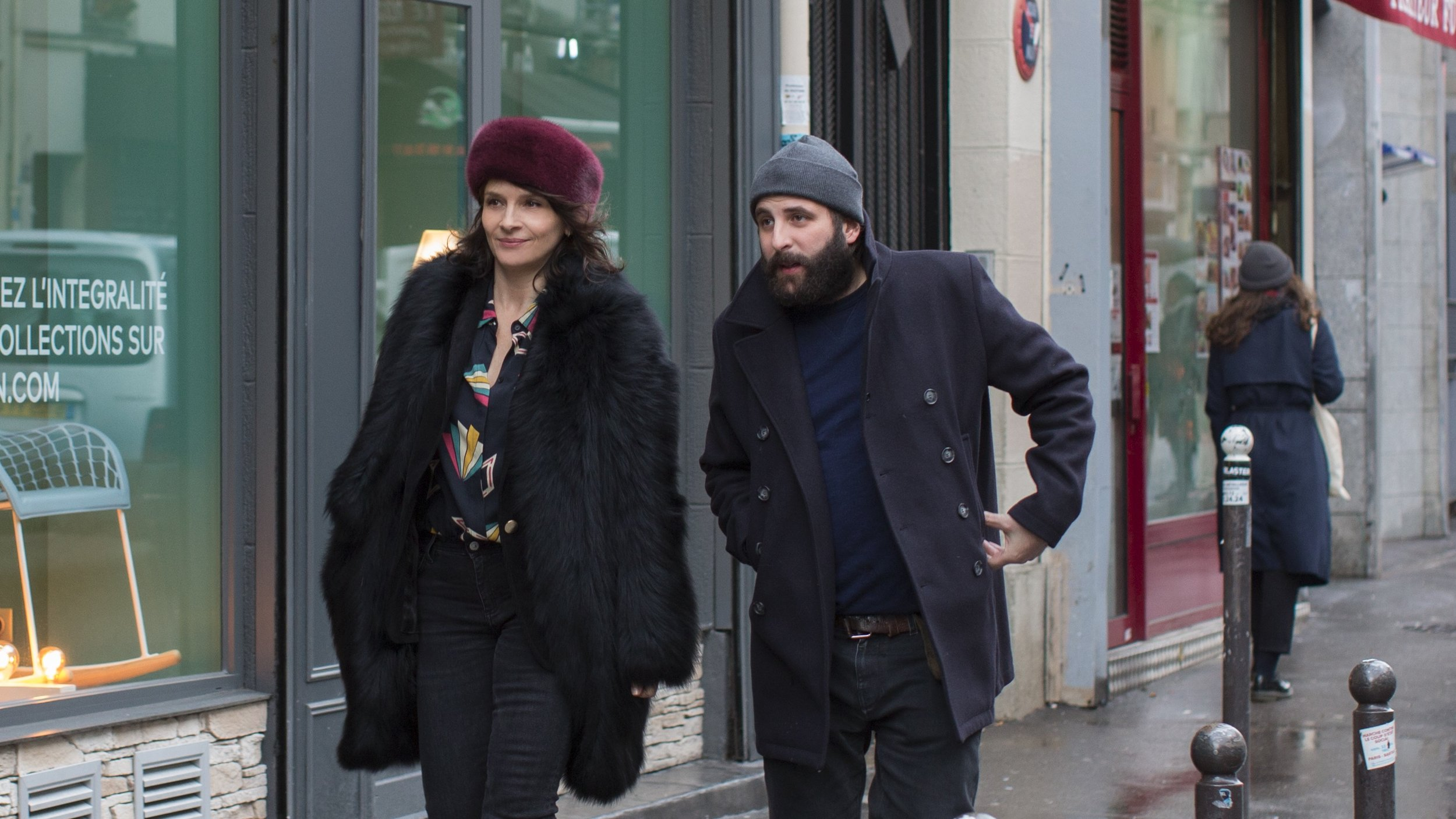 """Selena (Juliette Binoche, left), a TV actress, goes out on the town with Leonard (Vincent Macaigne), an author who wrote a thinly veiled version of their affair into his latest novel, in Olivier Assayas' comedy """"Non-Fiction""""."""" (Photo courtesy IFC Films / Sundance Selects.)"""
