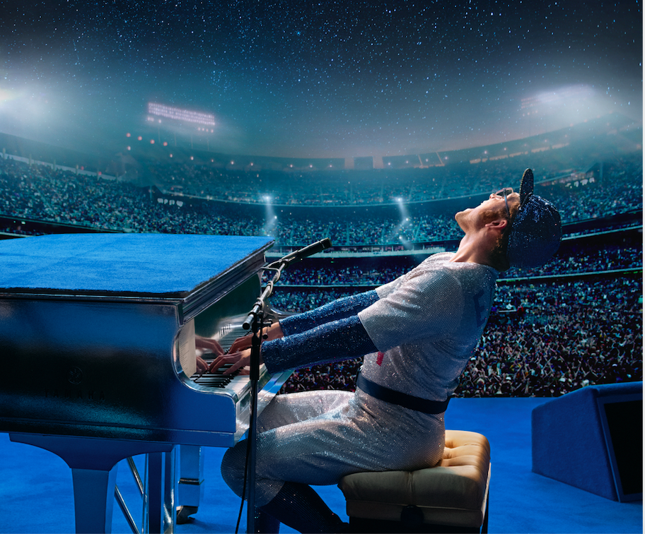 "Taron Egerton portrays Elton John, here performing his famous Dodger Stadium concert, in the musical biography ""Rocketman."" (Photo courtesy Paramount Pictures.)"