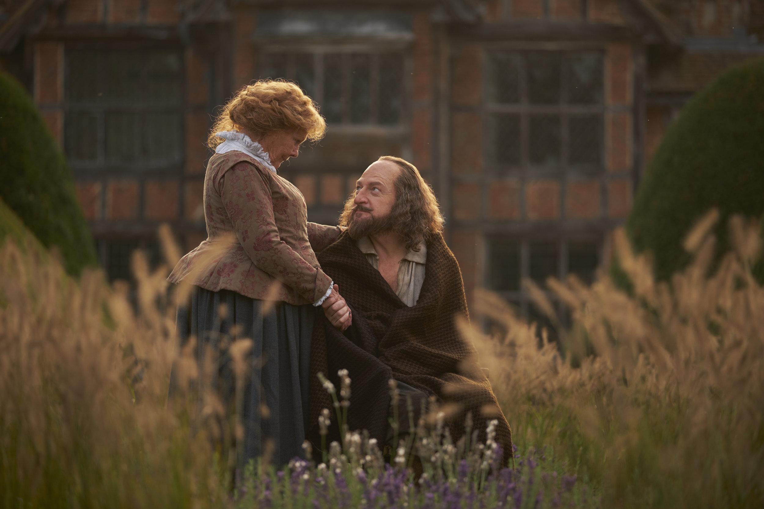 "A retired William Shakespeare (Kenneth Branagh, right) shares a quiet moment with his wife, Anne Hathaway (Judi Dench), in the drama ""All Is True,"" directed by Branagh. (Photo by Robert Youngson, courtesy of Sony Pictures Classics.)"