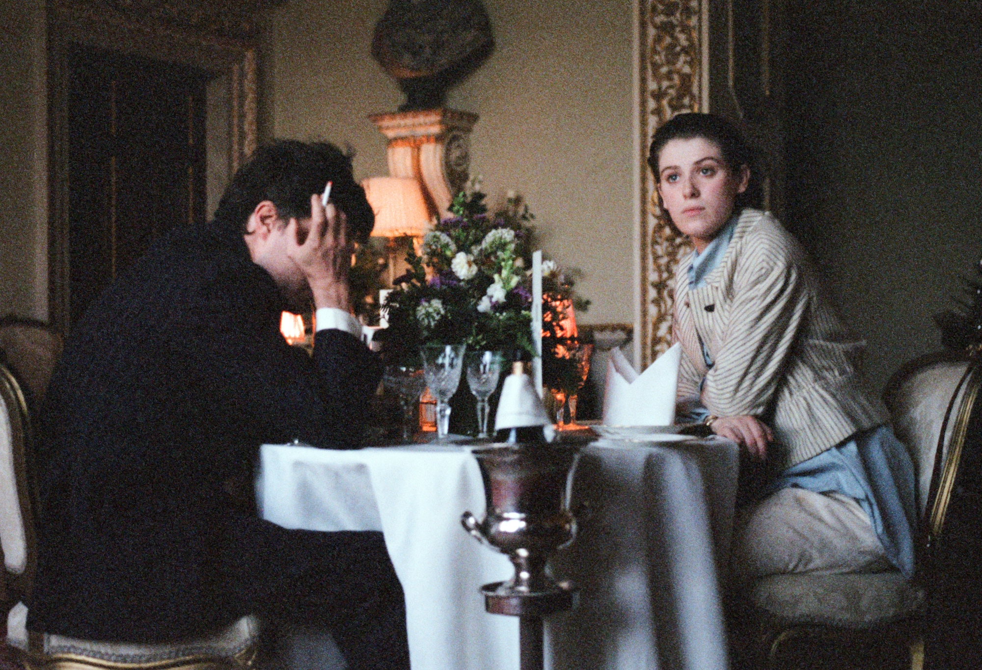 "Julie (Honor Swinton Burke, left), a young film student, strikes up an unsettling romance with an older man, Anthony (Tom Burke), in writer-director Joanna Hogg's drama ""The Souvenir."" (Photo by Agatha A. Nitecka, courtesy of A24 Films.)"