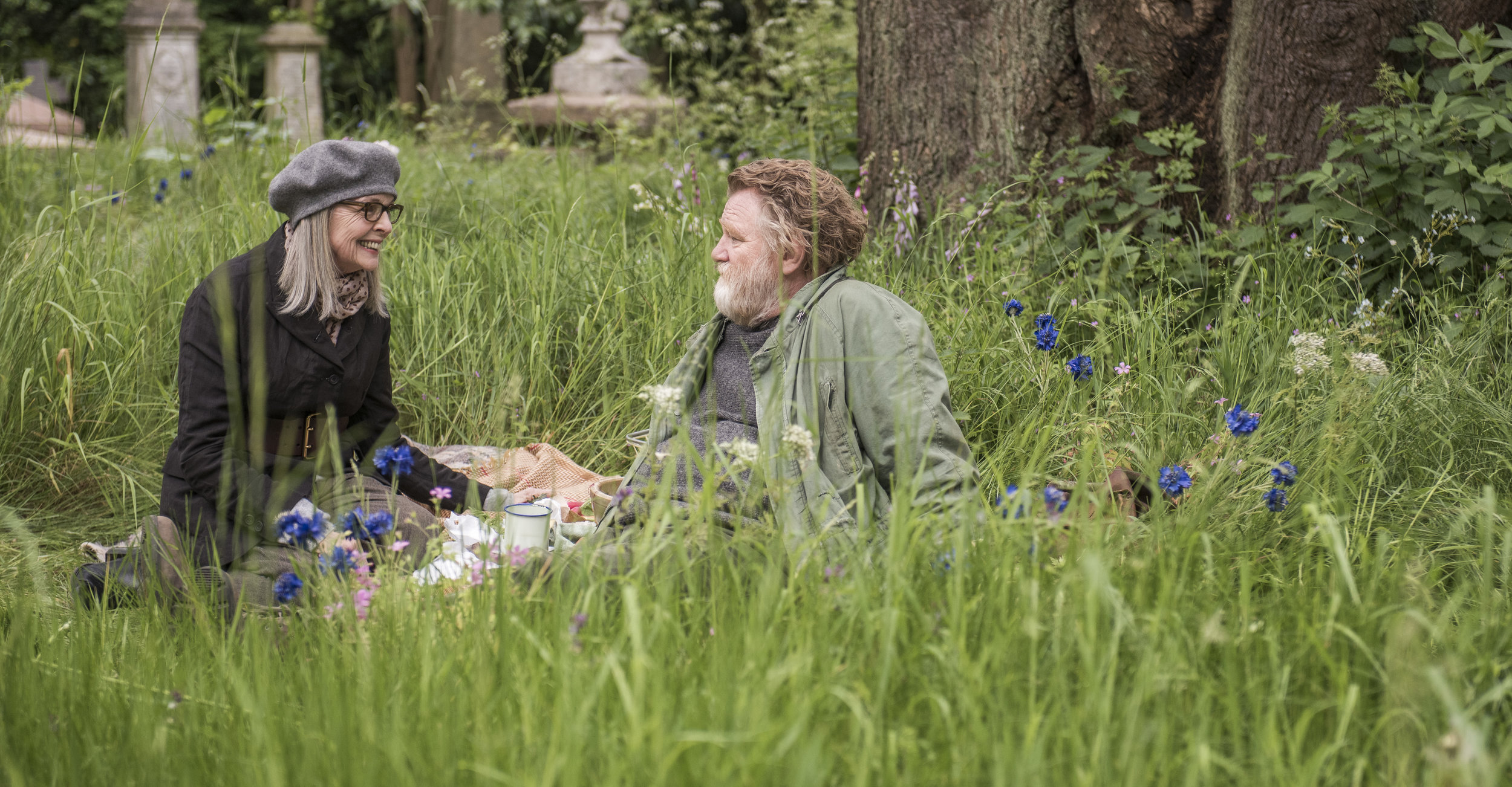 "Emily (Diane Keaton, left), an American widow in London, and Donald (Brendan Gleeson), who lives in a shack he built on park land, strike up an unlikely friendship in the romance ""Hampstead."" (Photo by Nick Wall, courtesy of IFC Films.)"